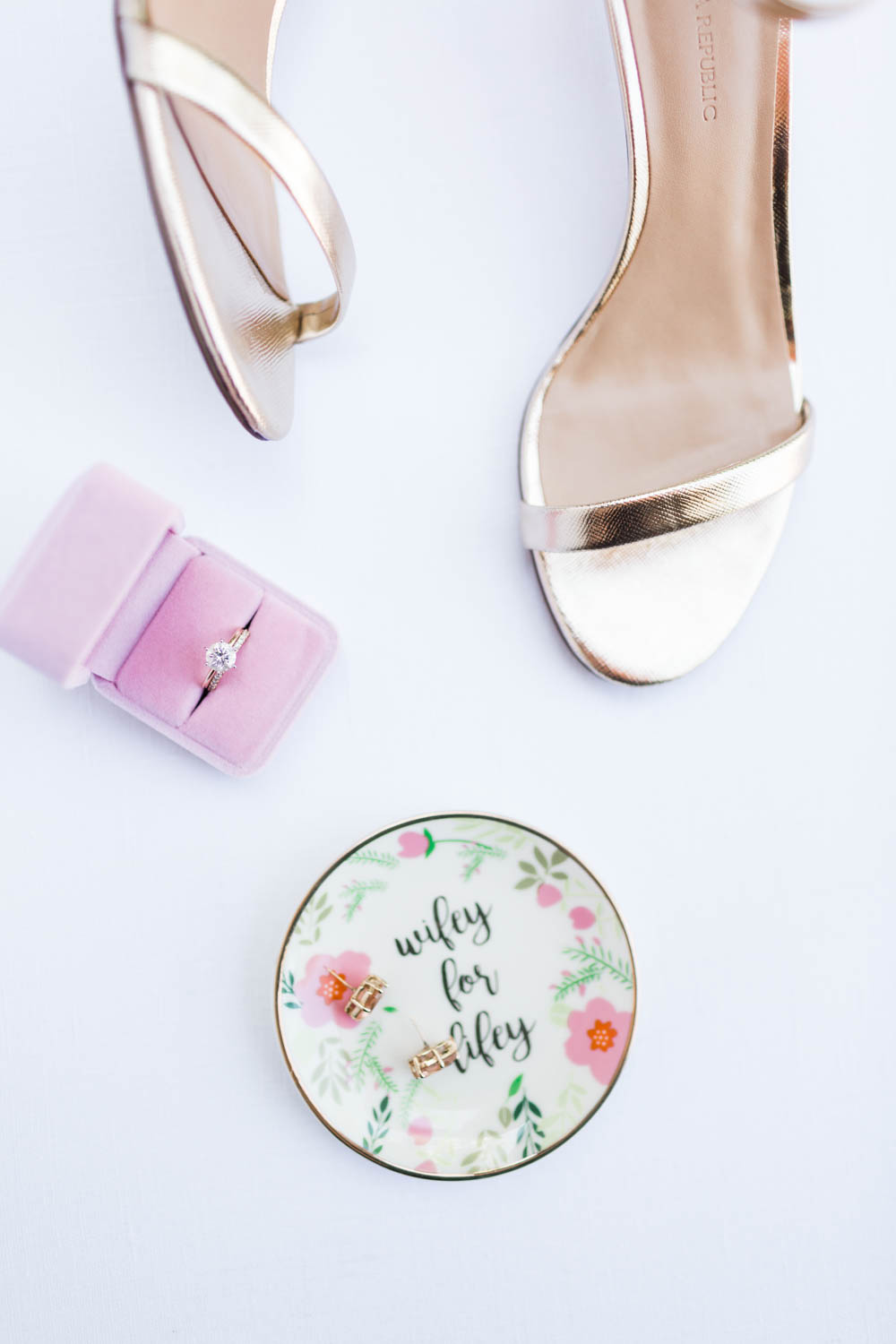 Sophisticated wedding flatlay with gold strappy heels and ring dish and pink velvet ring box, Cavin Elizabeth Photography