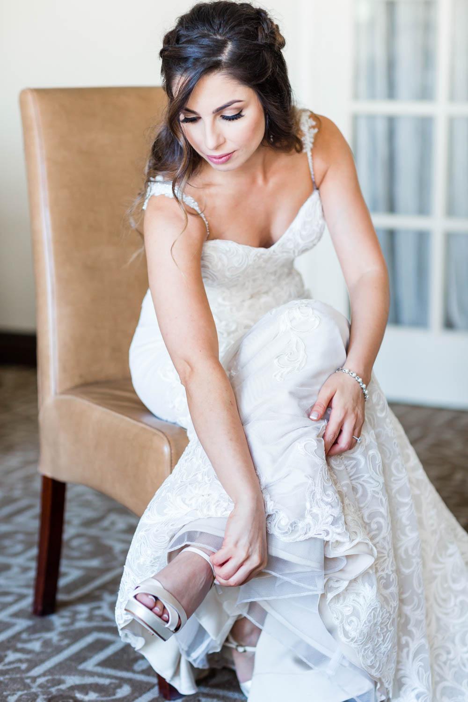 Bride putting on her Kate Spade wedding heels, Cavin Elizabeth Photography