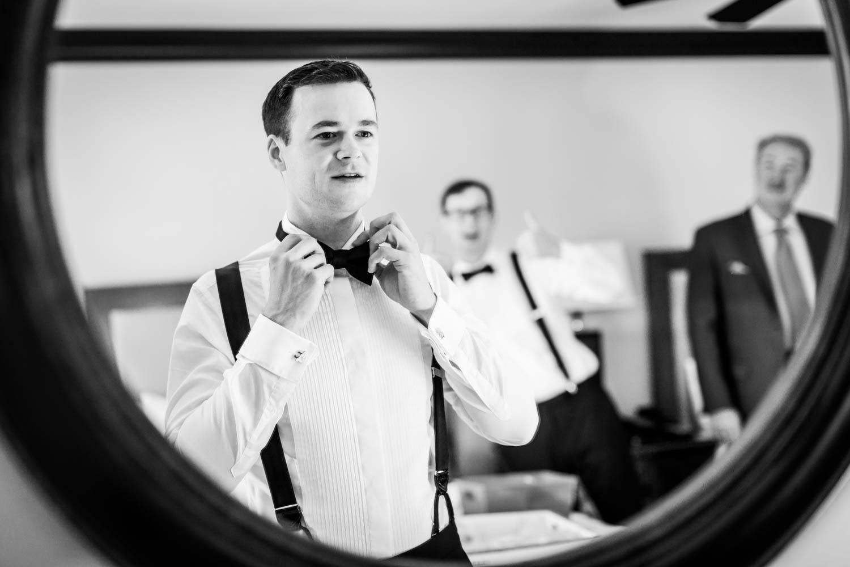 Groom getting ready for his Vibrant Winter Wedding at Omni Rancho Las Palmas, Cavin Elizabeth Photography