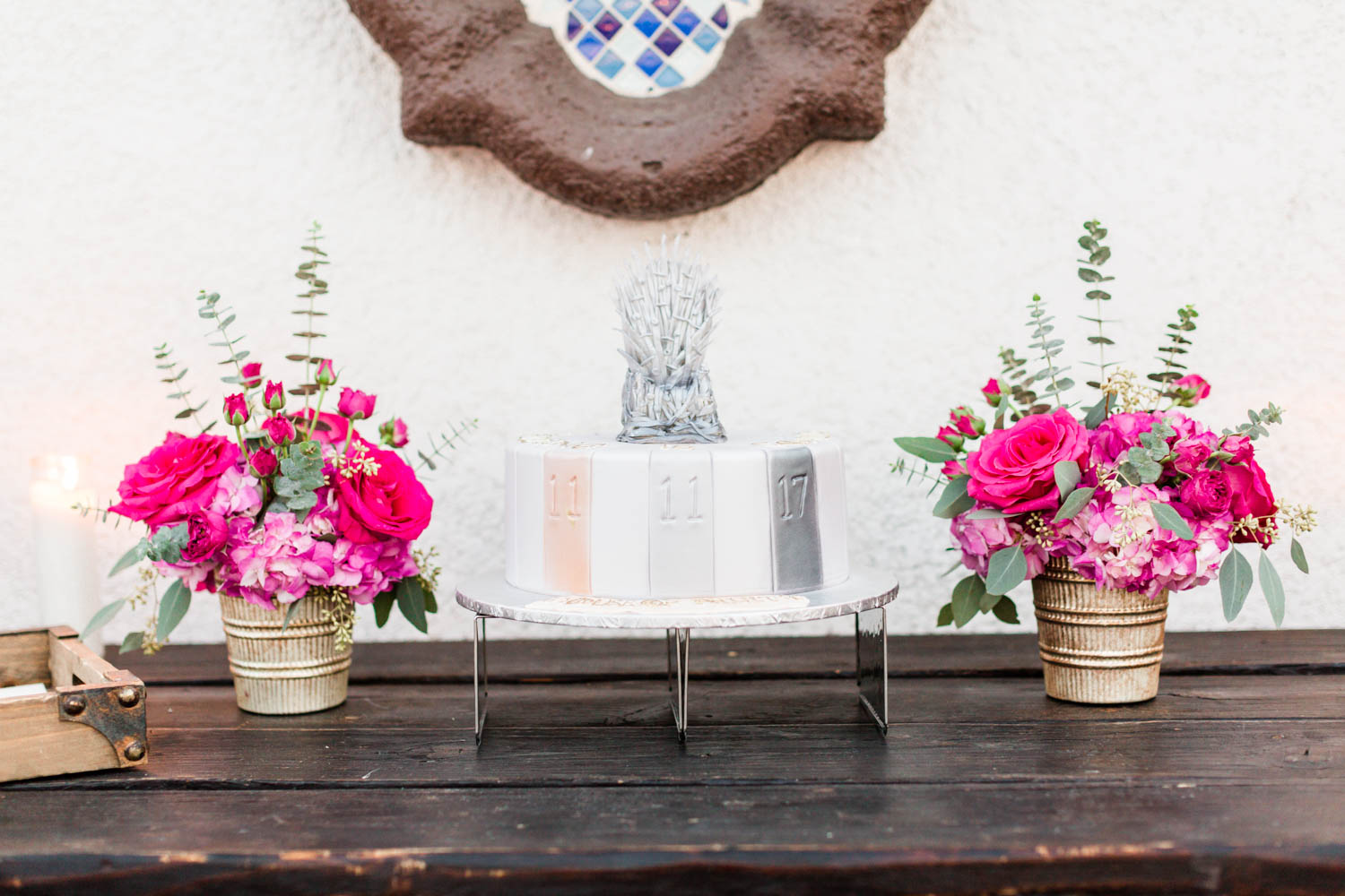 Game of Thrones wedding cake surrounded by pink and green flower arrangements, Cavin Elizabeth Photography