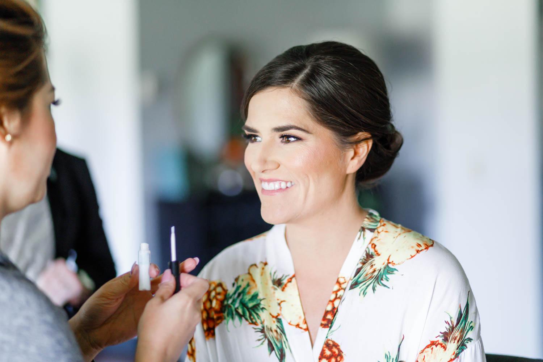 Bride getting makeup done for her Vibrant Winter Wedding at Omni Rancho Las Palmas, Cavin Elizabeth Photography
