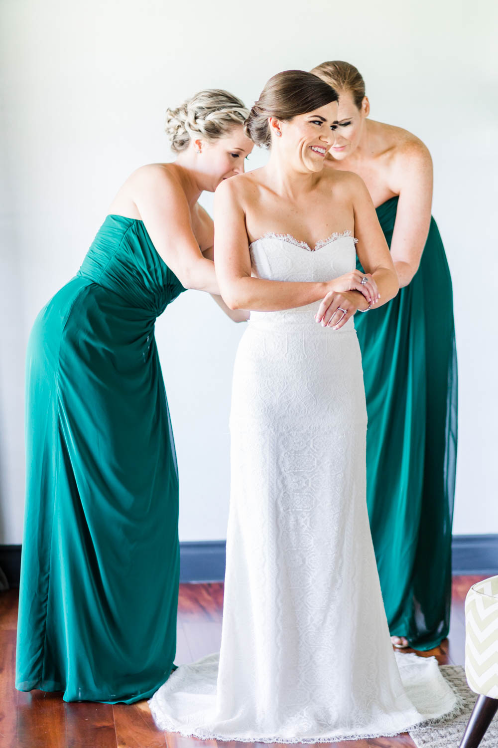 Bride getting on her gown for her Vibrant Winter Wedding at Omni Rancho Las Palmas, Cavin Elizabeth Photography