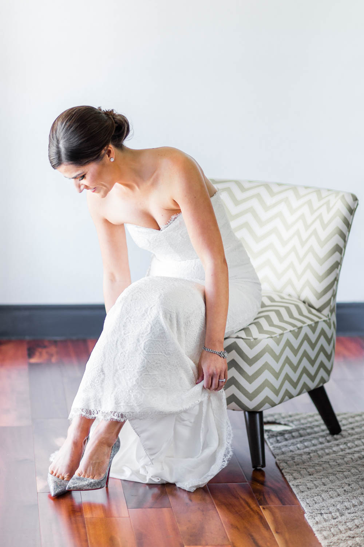Bride putting on Louboutin heels for her Vibrant Winter Wedding at Omni Rancho Las Palmas, Cavin Elizabeth Photography