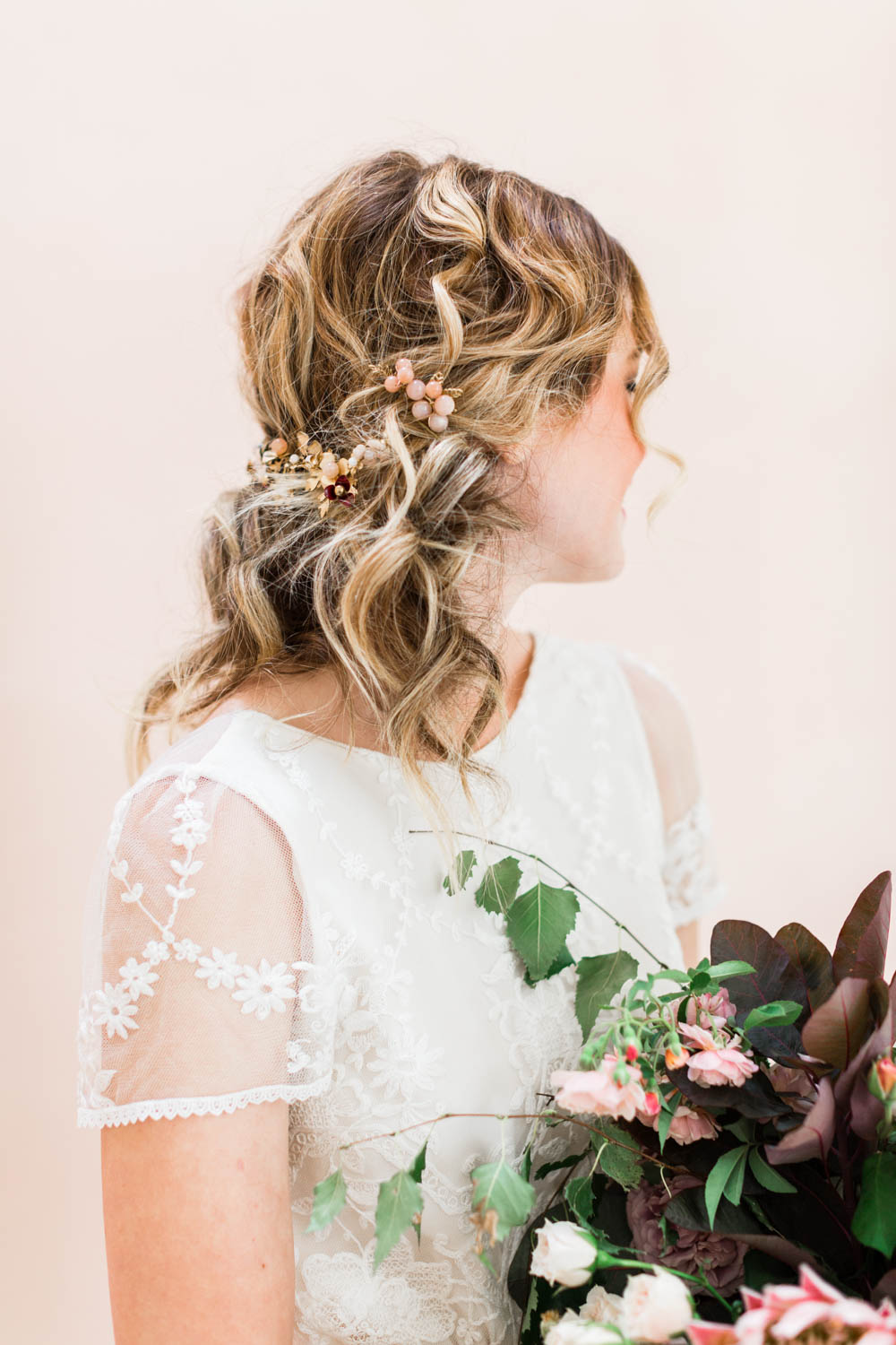 Bridal hair piece, Bride holding bouquet of pink green deep colors with pops of white by Oak and the Owl, Cavin Elizabeth Photography