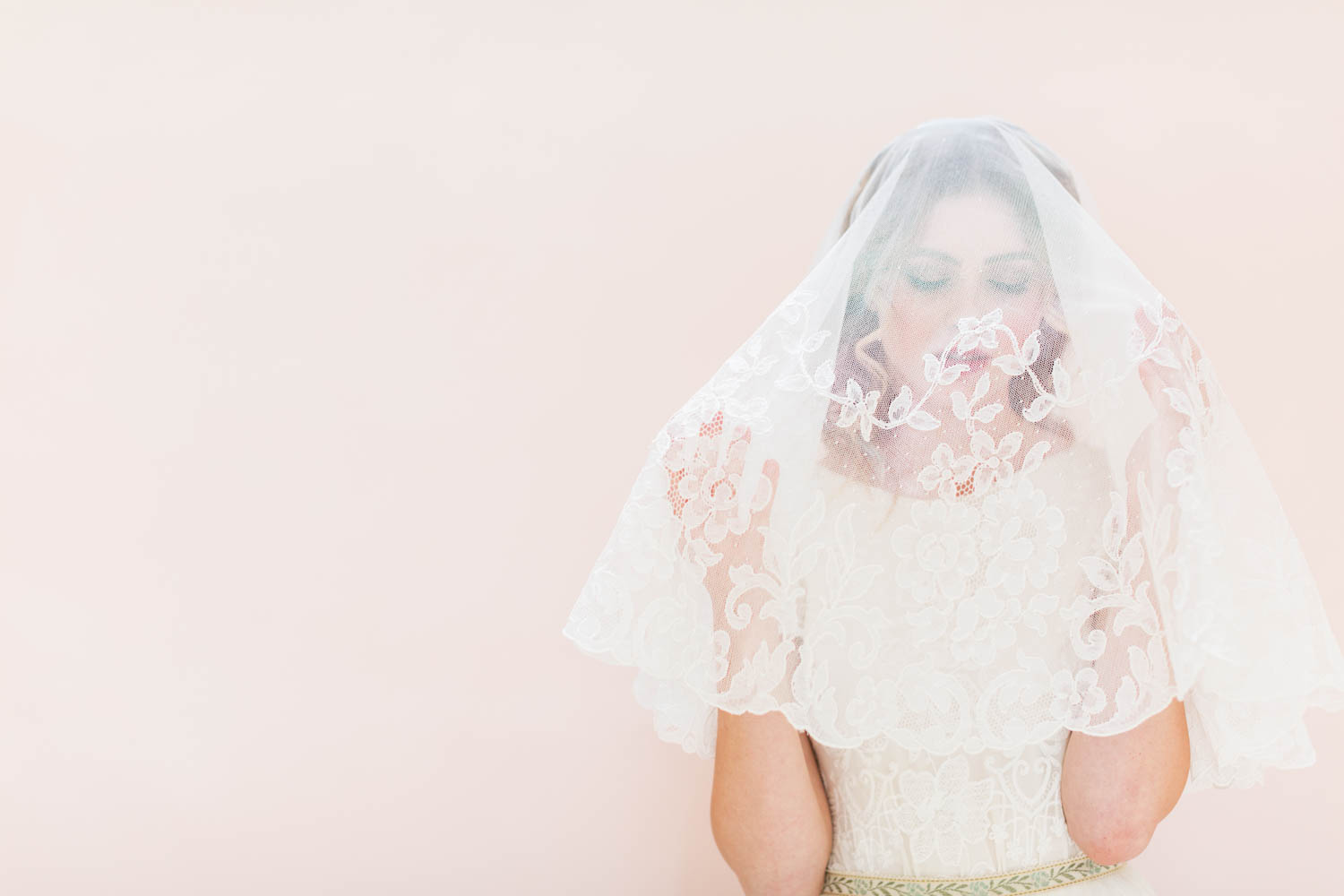 Bride under veil moody shot, Bride wearing Jean Dousset Chelsea ring and lace short sleeved wedding gown by Christina Sfez, Cavin Elizabeth Photography and Amorology