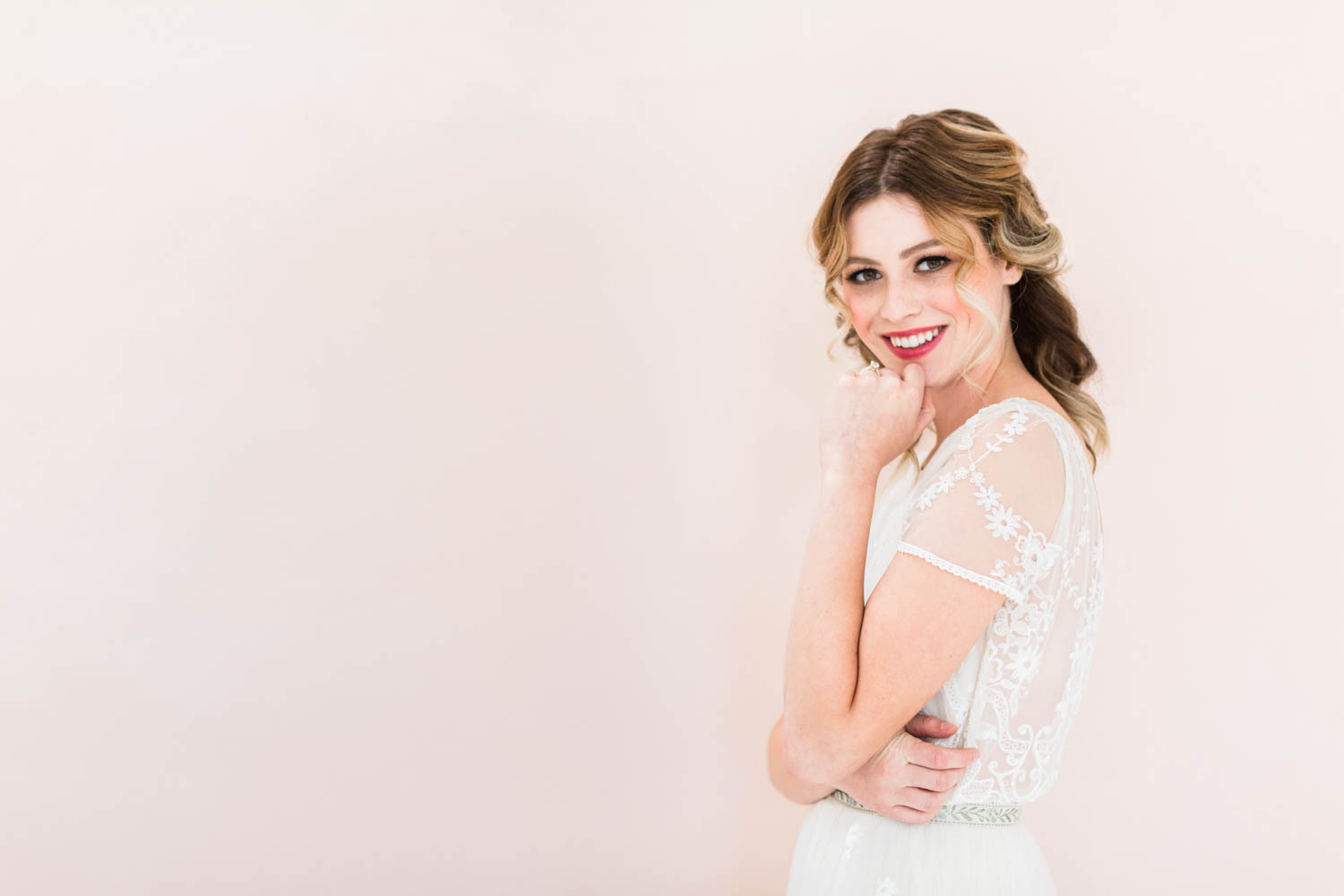 Bride wearing Jean Dousset Chelsea ring and lace short sleeved wedding gown by Christina Sfez, Cavin Elizabeth Photography and Amorology