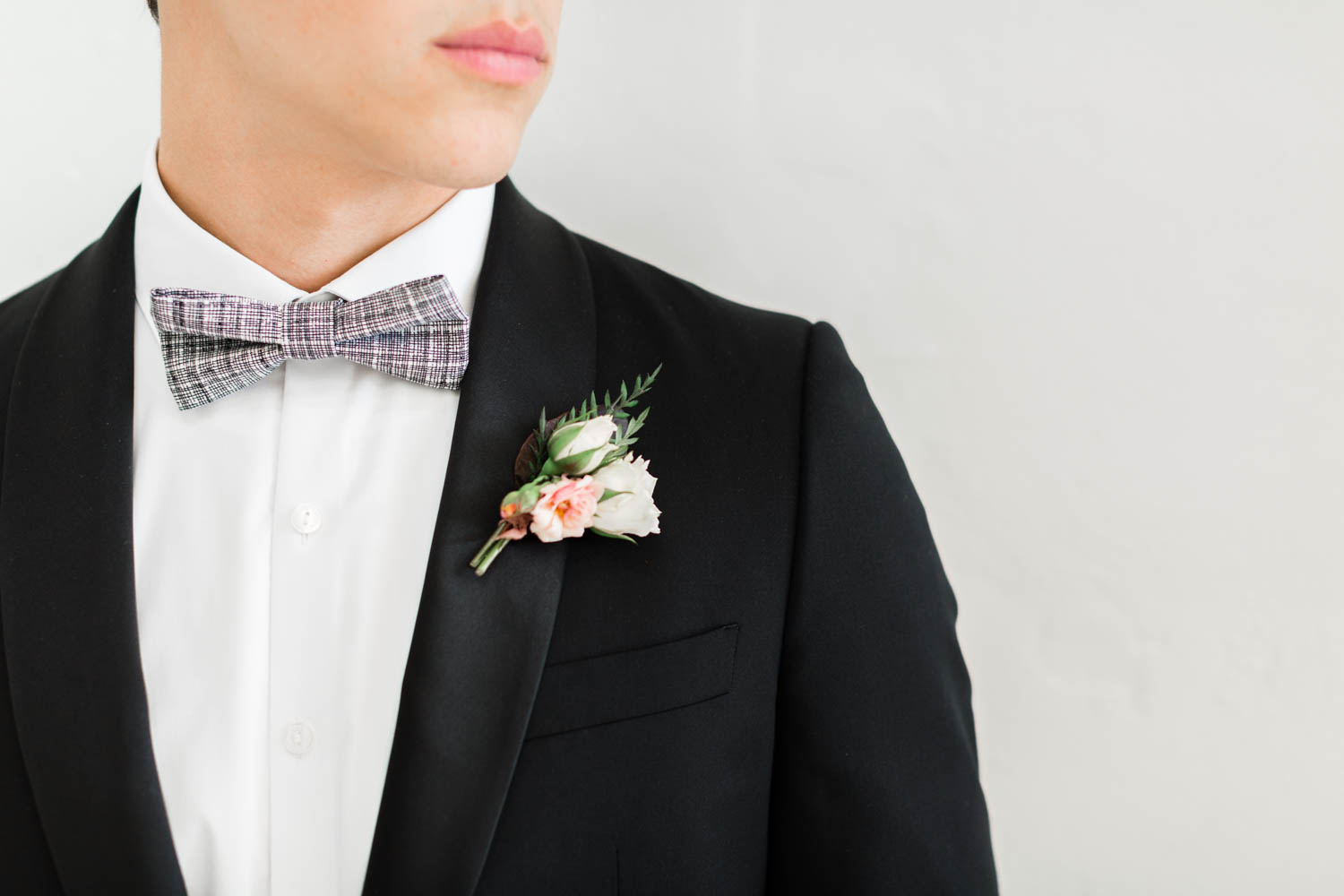 Groom wearing boutonniere of pink green deep colors with pops of white by Oak and the Owl, Cavin Elizabeth Photography