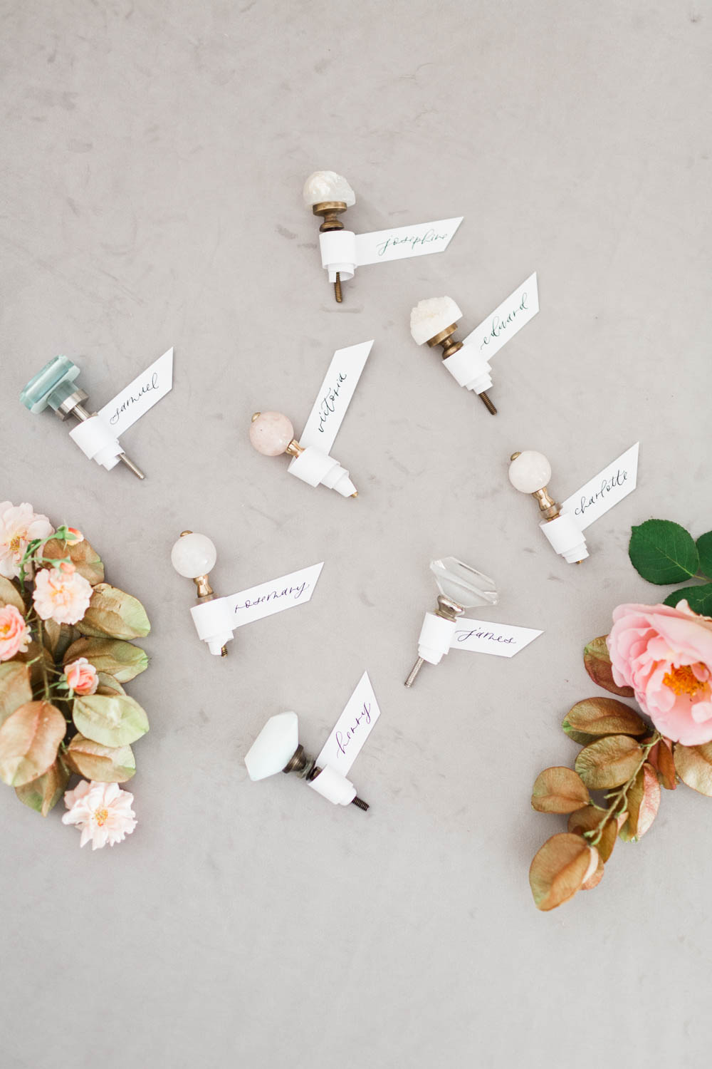 Escort cards made to look like perfume bottles with calligraphy scrolls wrapped around door knobs, Cavin Elizabeth Photography and Amorology
