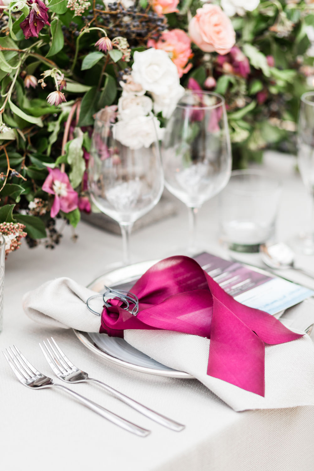 Magenta ribbon around napkin for place setting, Grey linen with organic white and peach and green floral centerpiece, Navy and magenta Details Details Holiday Party at Twenty Eight OC, Cavin Elizabeth Photography