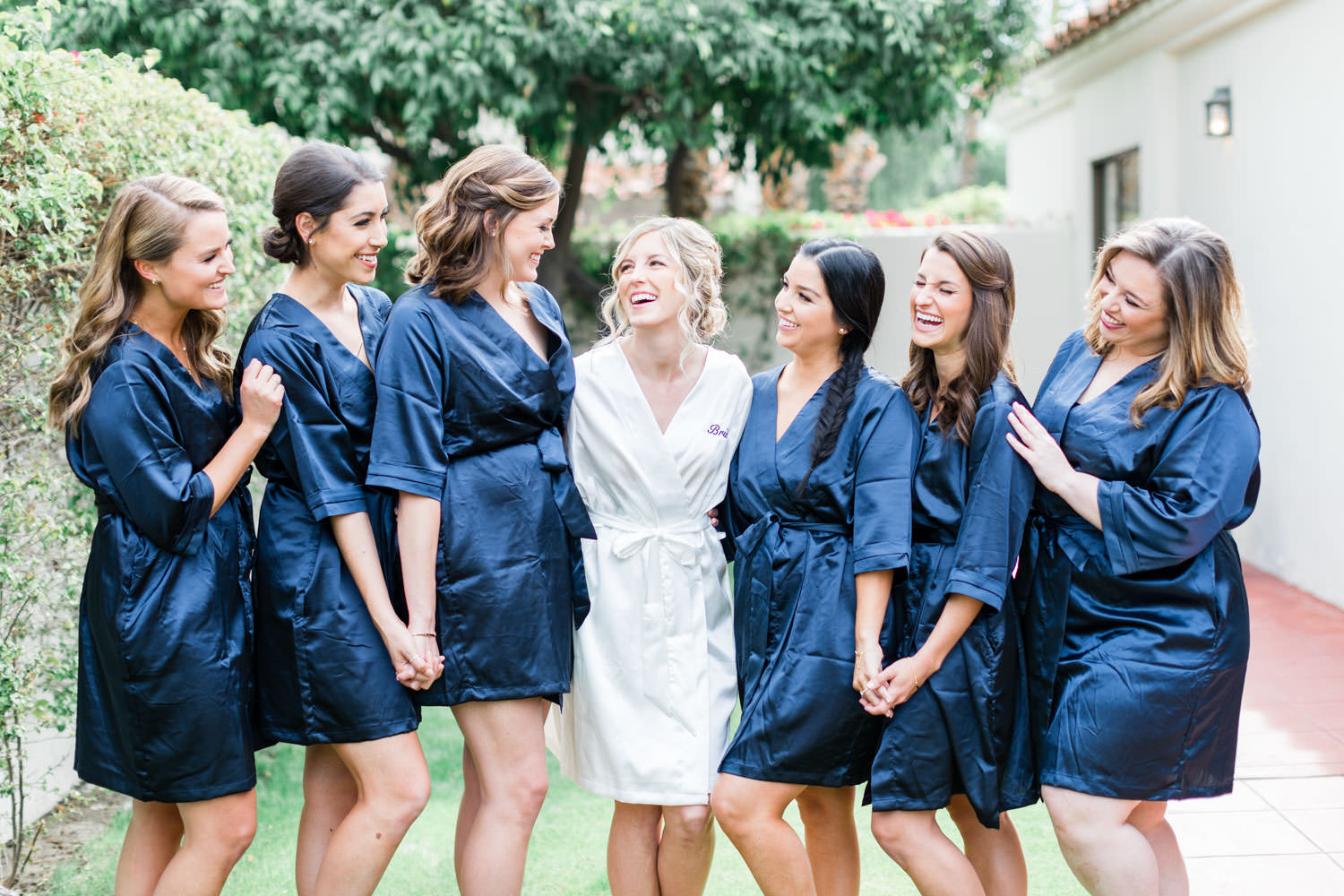 La Quinta Resort, Bridesmaids in navy robes with the bride in a white robe, Cavin Elizabeth Photography