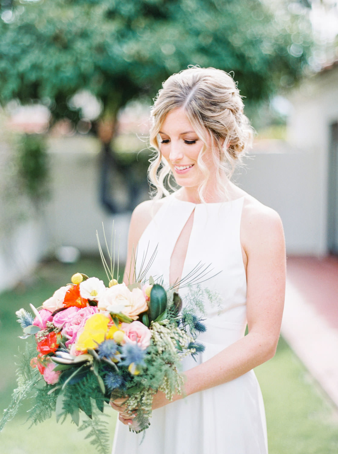Bride on 400h film with yellow pink and green bouquet, Bride getting into Rebecca Schoneveld Lincoln gown, Cavin Elizabeth Photography