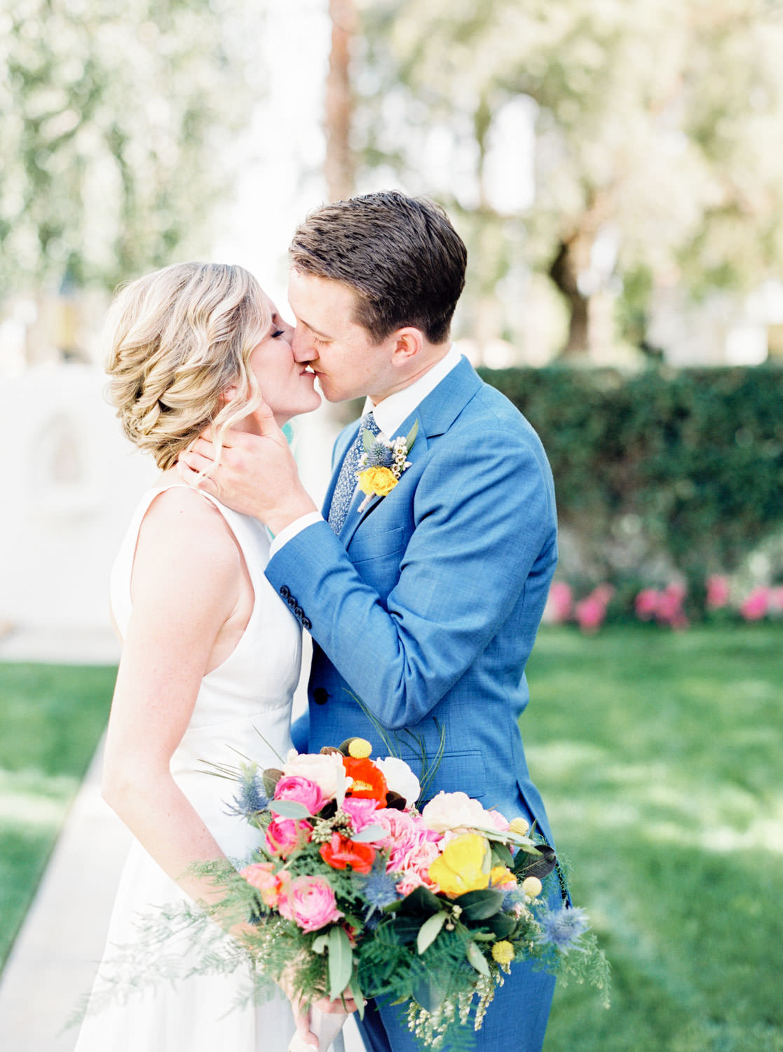 Bridal bouquet with pink yellow orange and green bouquet, Bride and groom portraits, groom in blue suit with yellow boutonniere, bride wearing Rebecca Schoneveld Lincoln gown, La Quinta Resort Wedding in Palm Springs, Cavin Elizabeth Photography