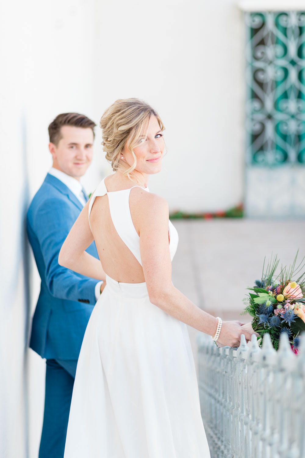 Bride and groom portraits, groom in blue suit with yellow boutonniere, bride wearing Rebecca Schoneveld Lincoln gown, La Quinta Resort Wedding in Palm Springs, Cavin Elizabeth Photography