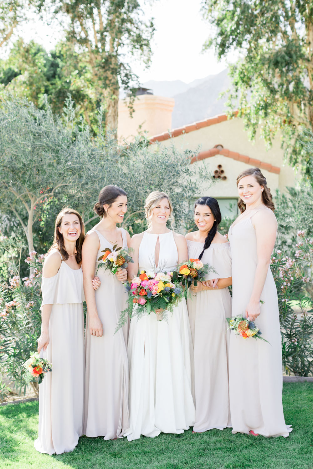 Bridal party at La Quinta Resort wedding with blue suits and neutral bridesmaids dresses, Cavin Elizabeth Photography