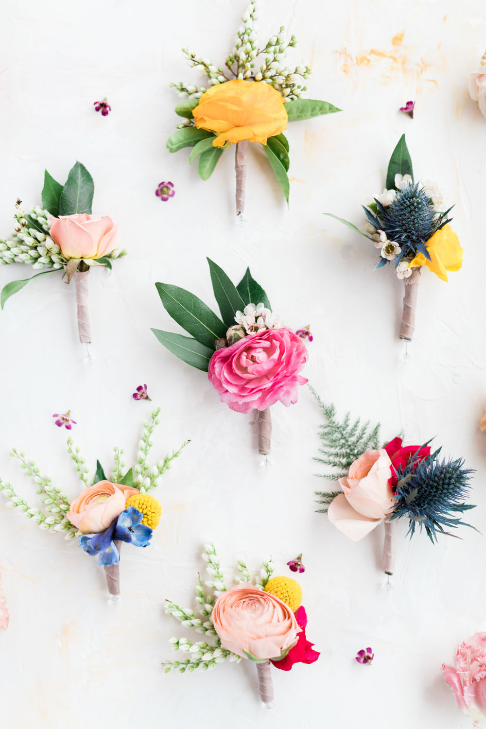 Pink blue red and yellow boutonnieres for a Palm Springs colorful wedding, La Quinta Resort Wedding in Palm Springs, Cavin Elizabeth Photography