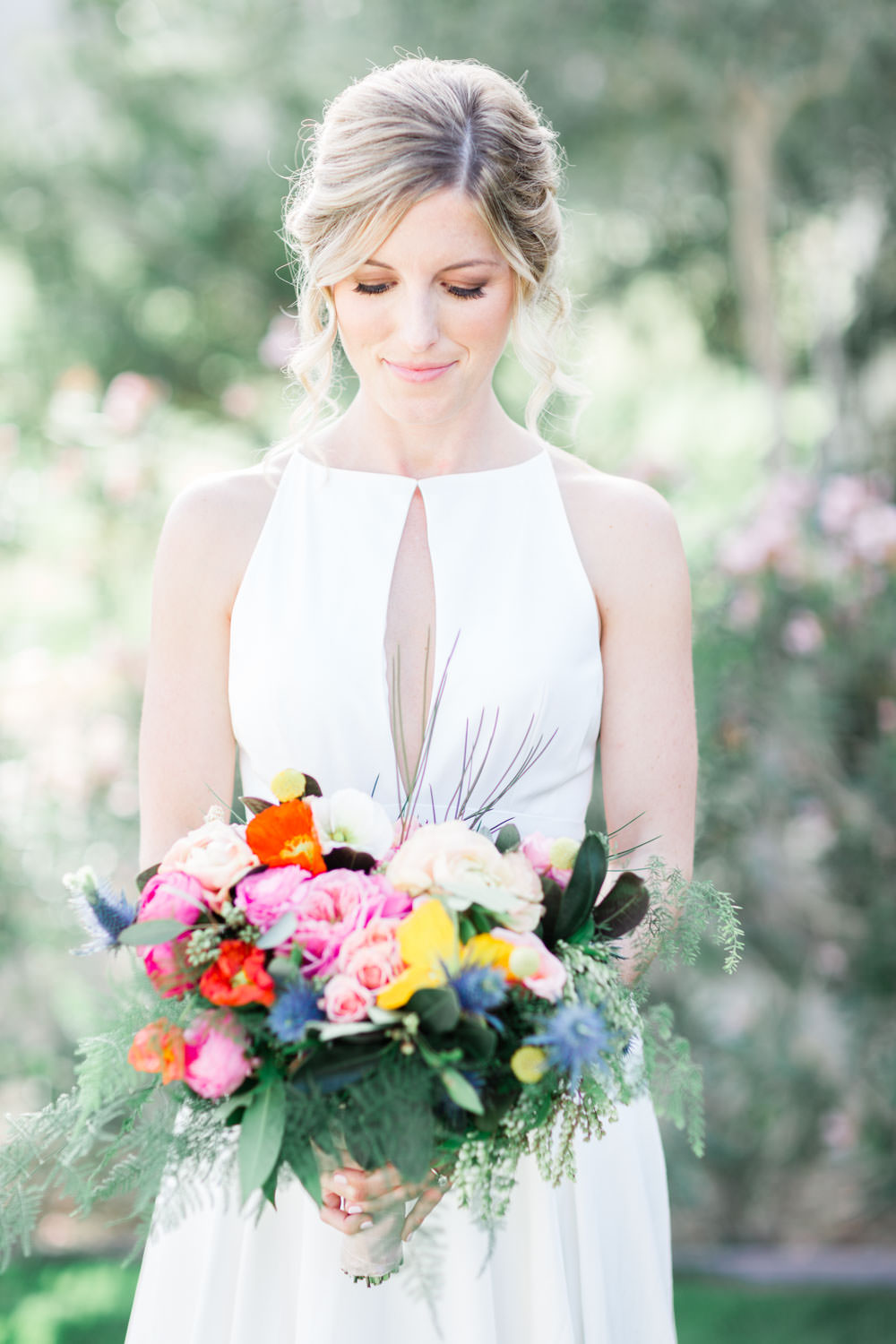 Bride at La Quinta Resort in Palm Springs holding a pink yellow red and green bouquet wearing a Lincoln gown by Rebecca Schoneveld gown, Cavin Elizabeth Photography