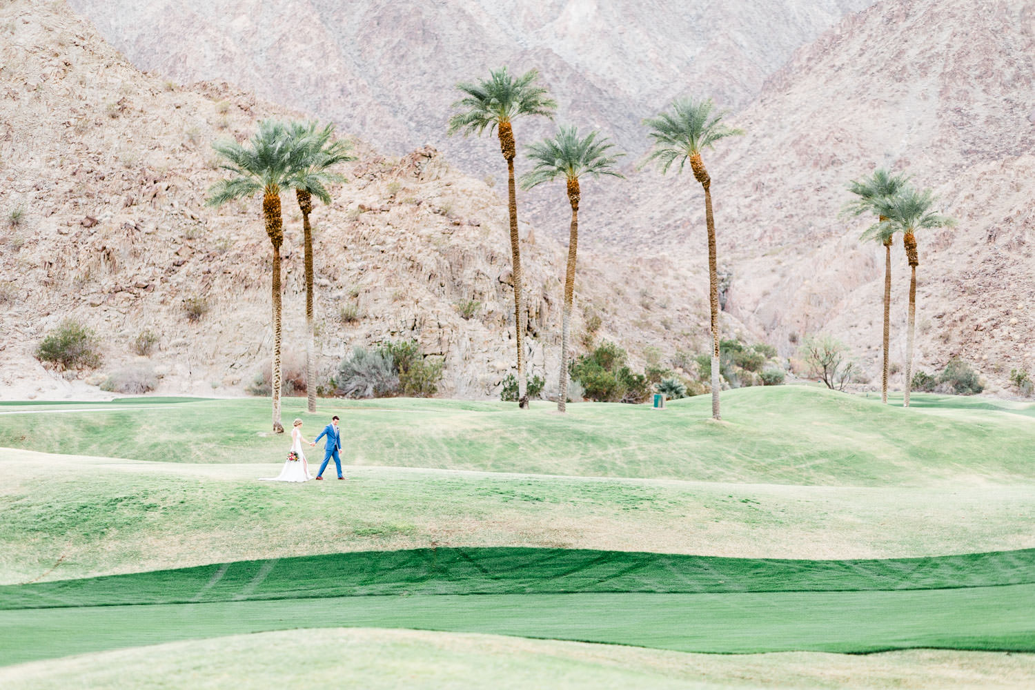 Epic landscape Palm Springs mountains wedding photo of a bride and groom, Cavin Elizabeth Photography at La Quinta Resort
