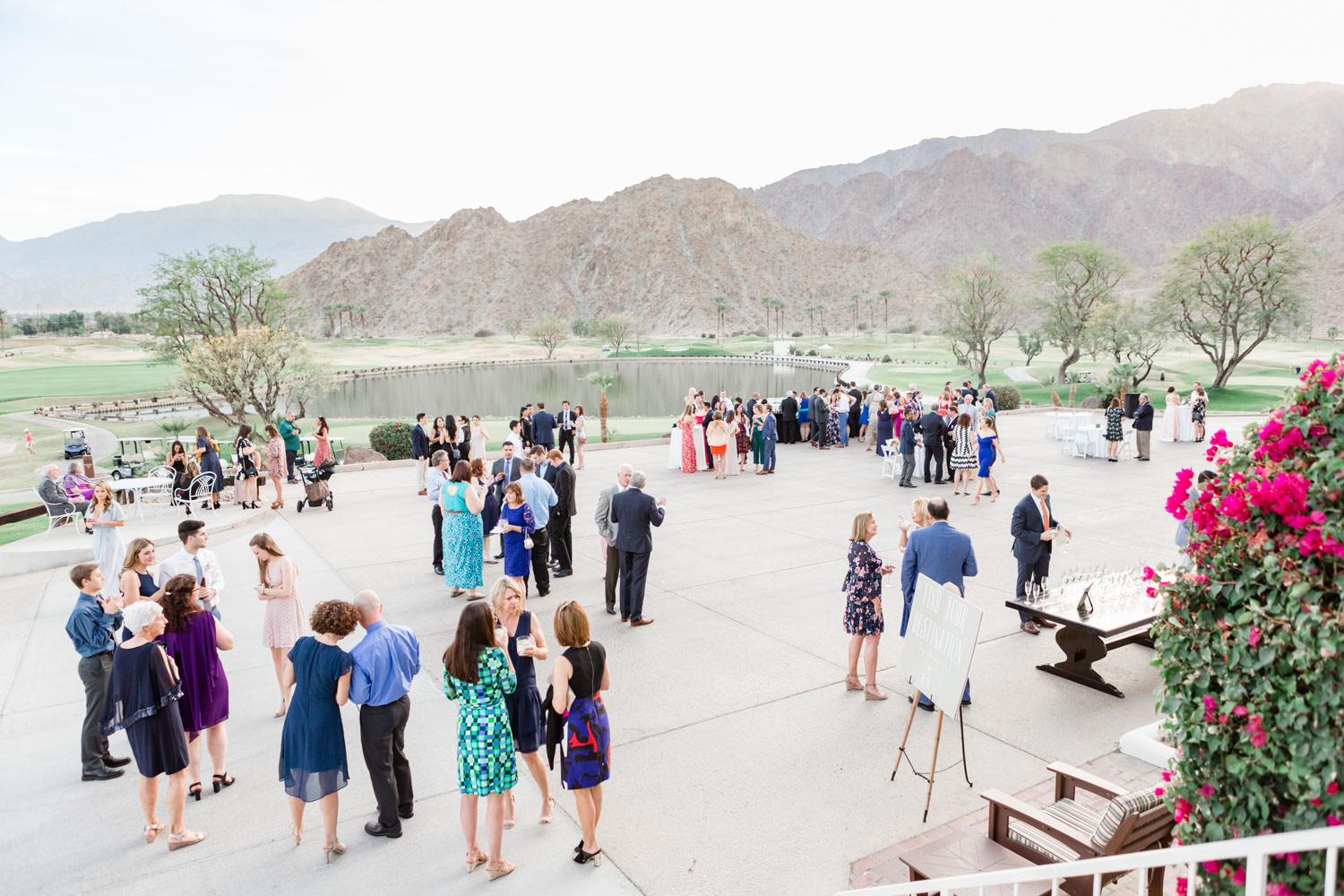 Cocktail hour by the clubhouse with mountains in the background for a La Quinta Resort wedding, Cavin Elizabeth Photography