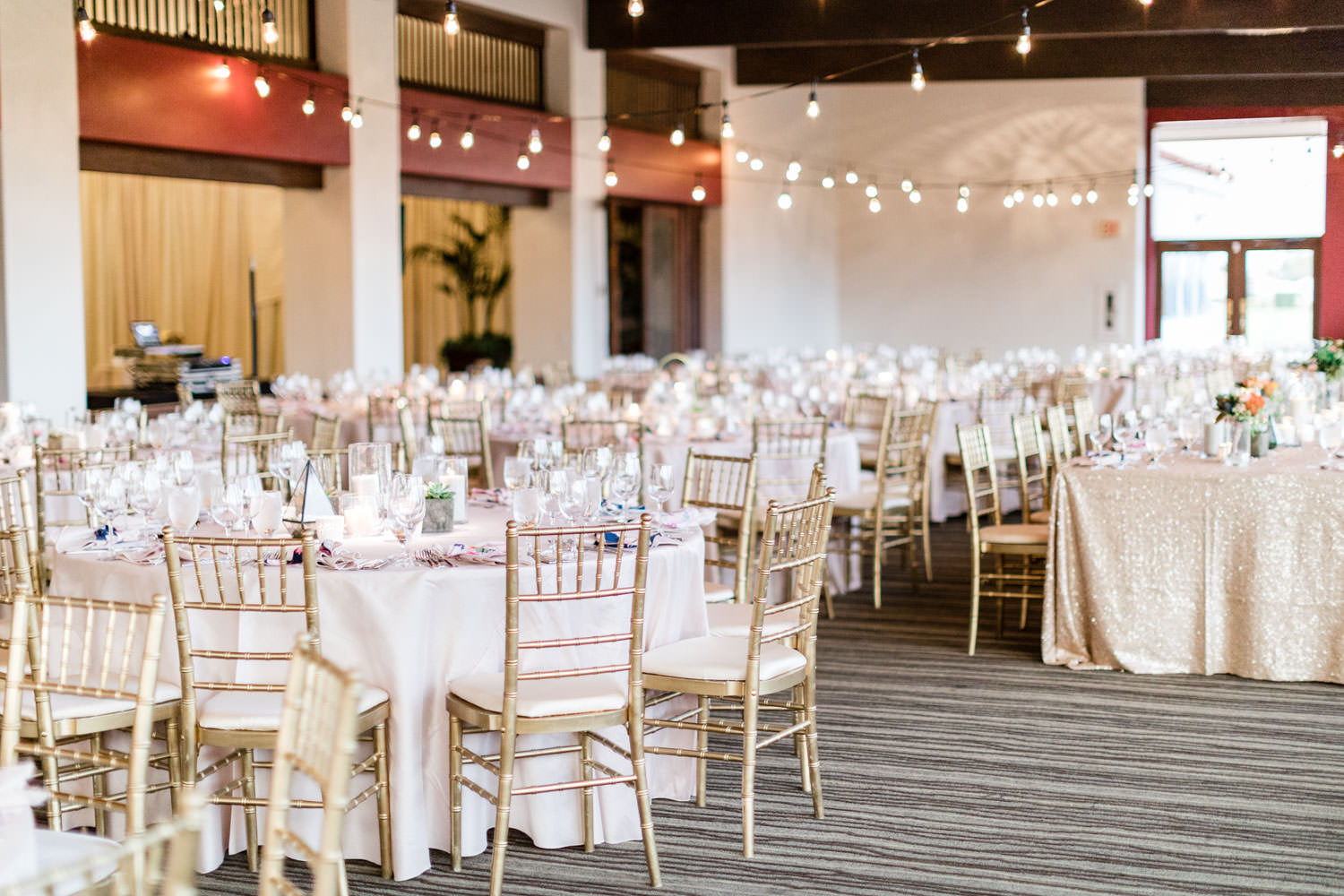 Reception with blush linens and market lights indoors, La Quinta Resort wedding, Cavin Elizabeth Photography