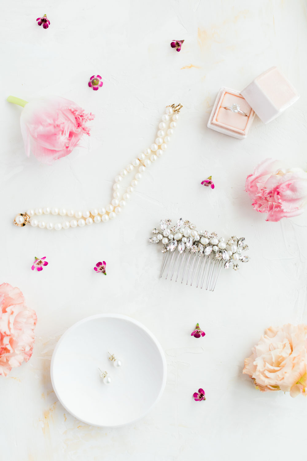 Bridal jewelry and hair comb styled with blush MRs Box and pink flowers, La Quinta Resort Wedding in Palm Springs, Cavin Elizabeth Photography