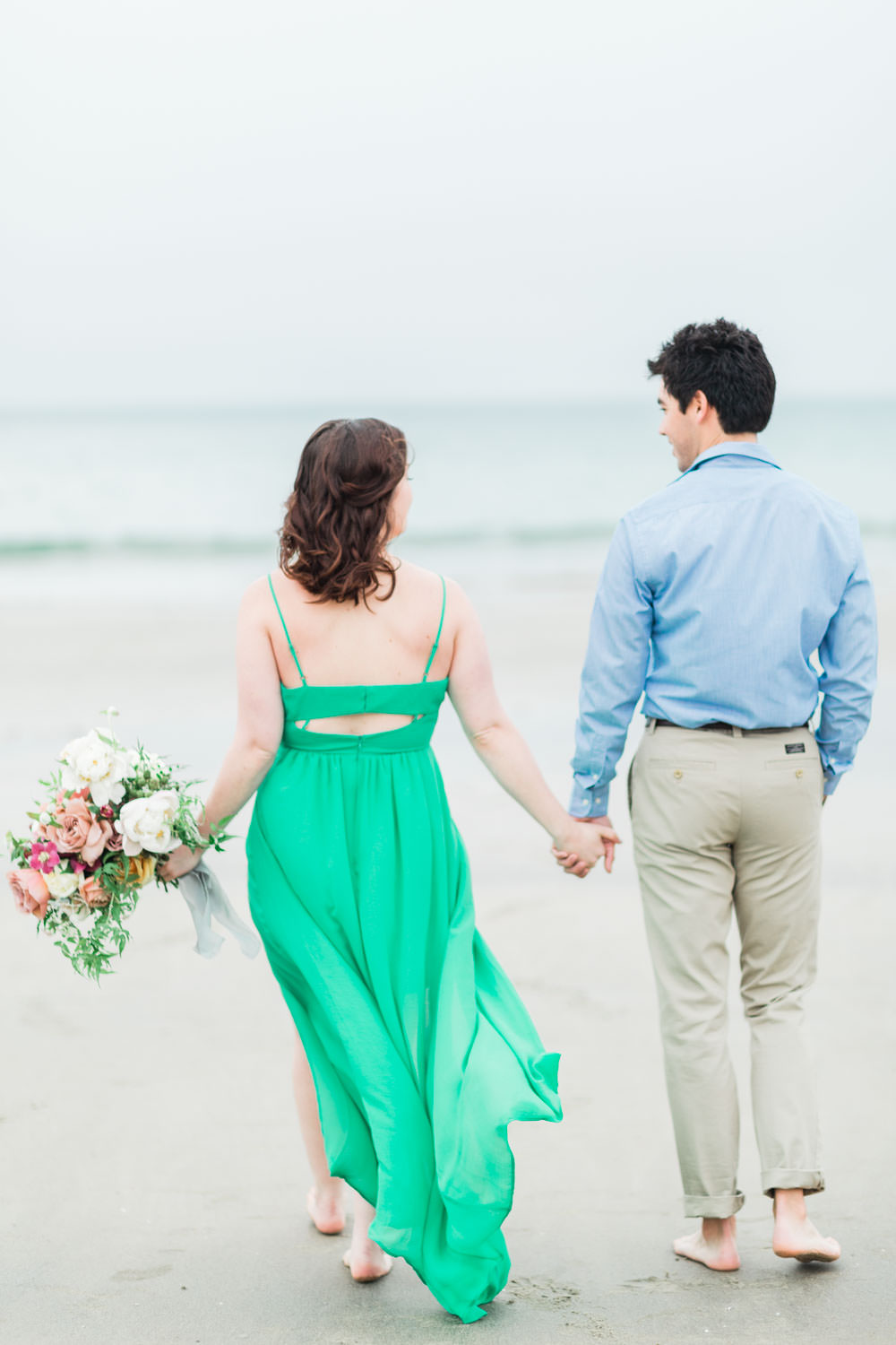 Engagement photos in La Jolla Shores, green flowy dress with pink mauve ivory and green bouquet, Cavin Elizabeth Photography