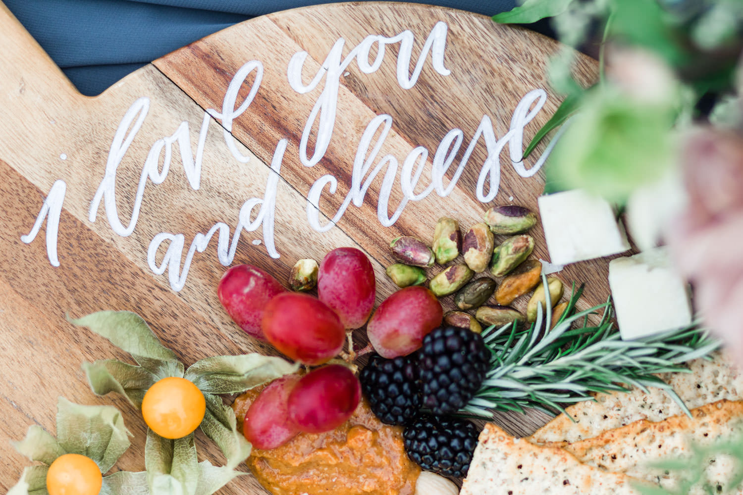 Calligraphy I love you and cheese on a cheese wooden board with fruits, Cavin Elizabeth Photography