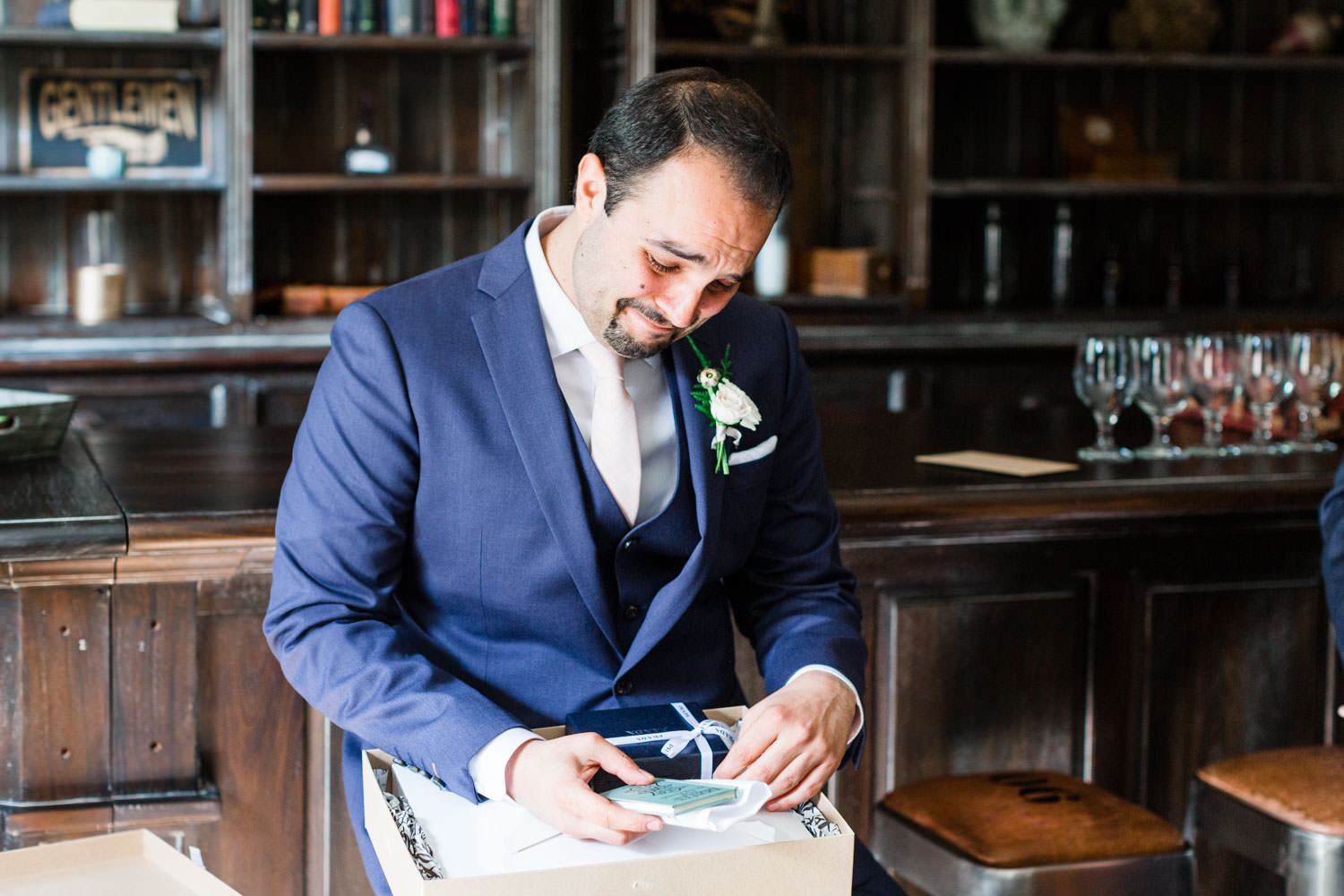 Groom crying while reading letter from the bride and opening a giftBride putting on Bella Belle shoes at Ethereal Open Air Resort, Cavin Elizabeth Photography