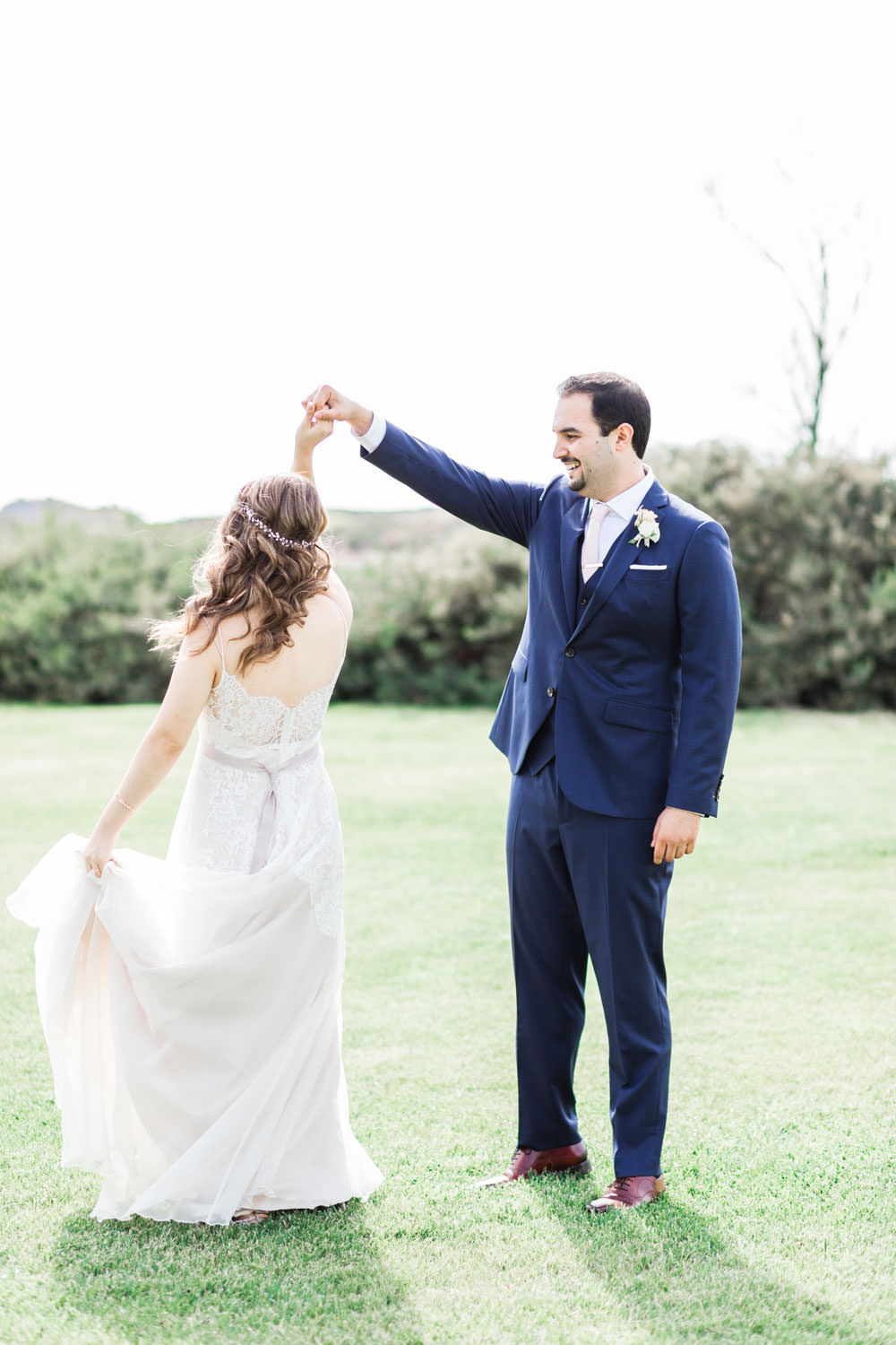 Wedding first look in a field between bride and groom at their Ethereal Open Air Resort Wedding, Cavin Elizabeth Photography