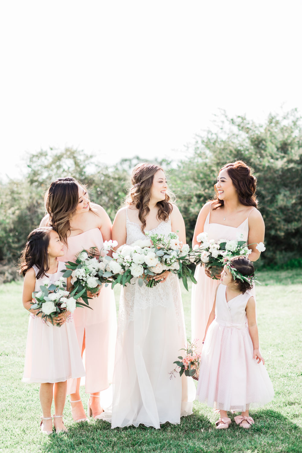 Bridal party in navy and blush at Ethereal Open Air Resort, Cavin Elizabeth Photography