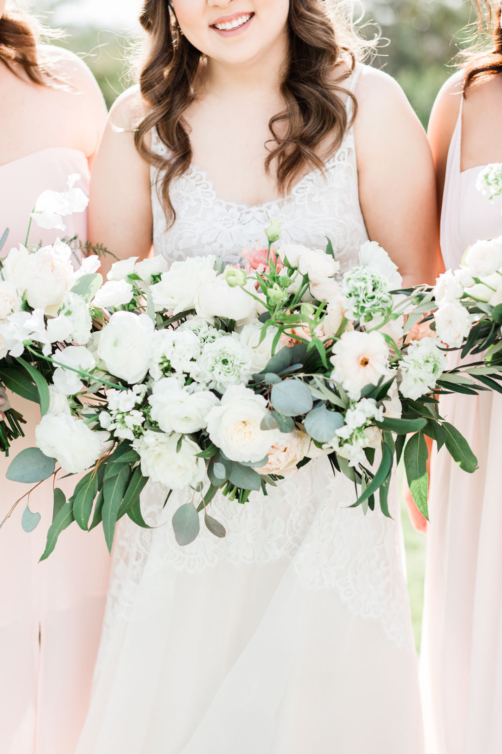 Bridal party bouquets with white and green at Ethereal Open Air Resort, Cavin Elizabeth Photography