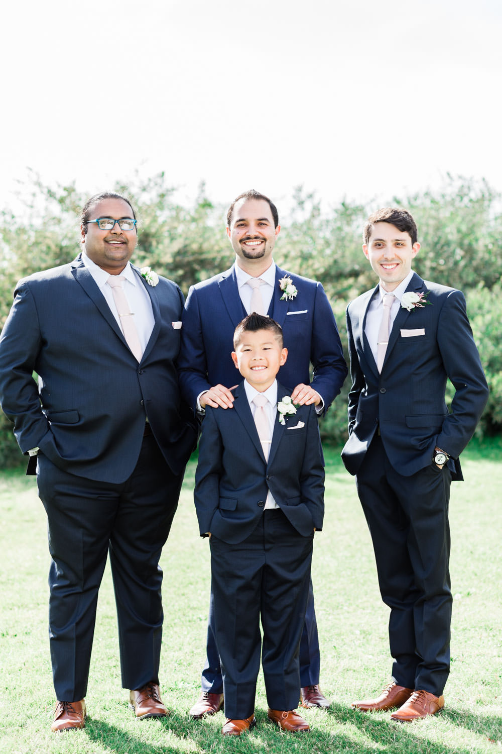 Groom and groomsmen in navy at Ethereal Open Air Resort, Cavin Elizabeth Photography