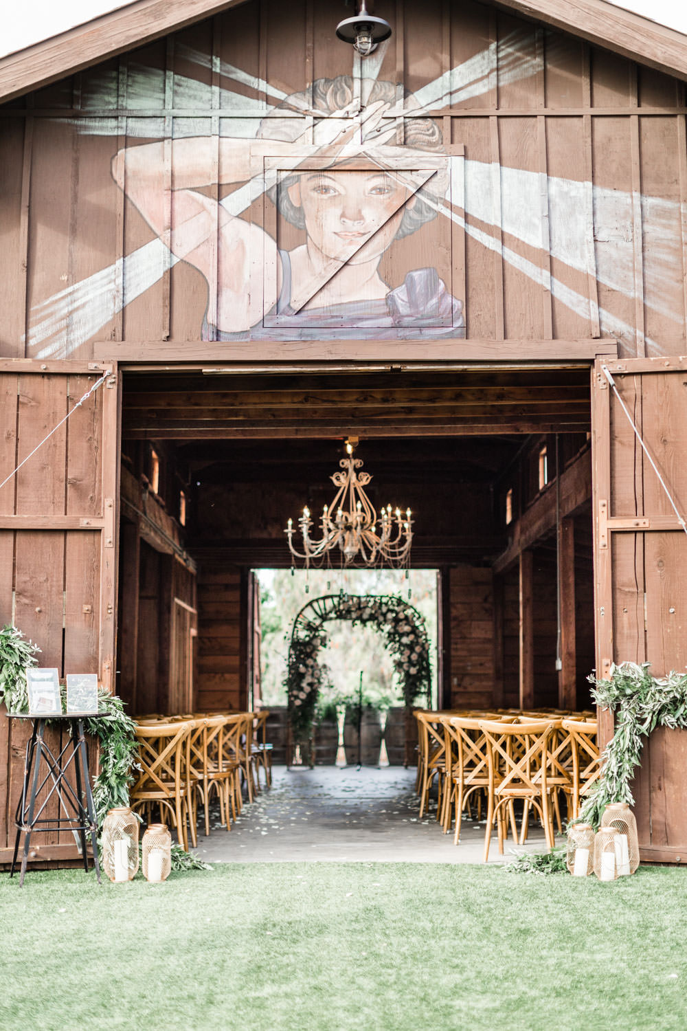 Ethereal Open Air Resort Wedding Ceremony in a barn with white green and blush flowers, Cavin Elizabeth Photography