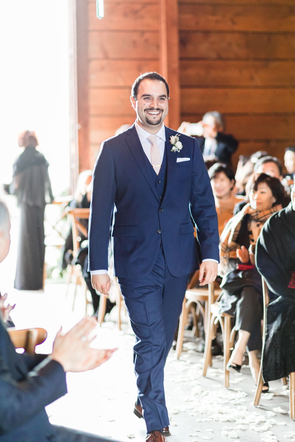 Groom walking down aisle for ceremony at Ethereal Open Air Resort, Cavin Elizabeth Photography