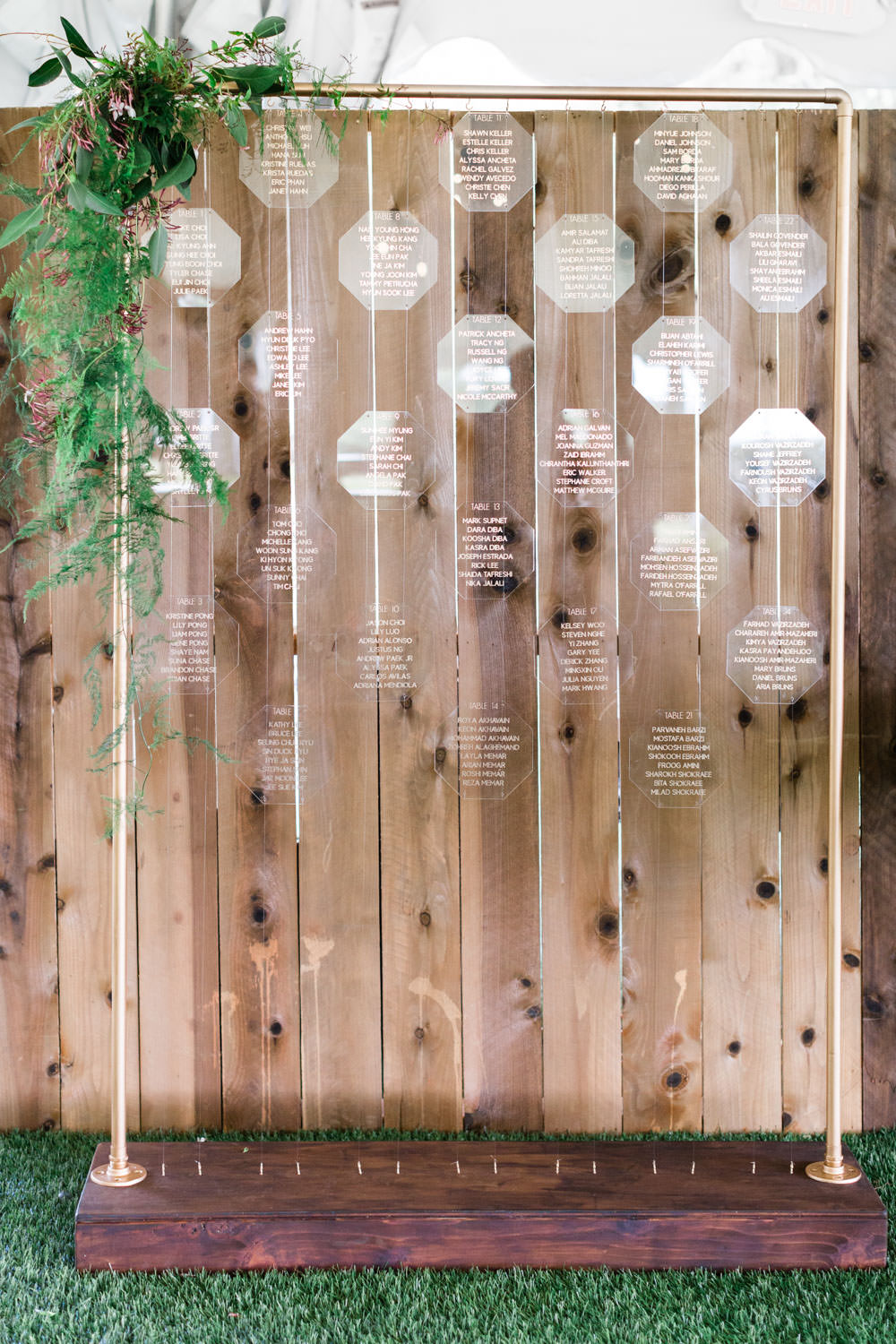 Escort card table made from hanging acrylic clear geometric cards with greenery, Cavin Elizabeth Photography