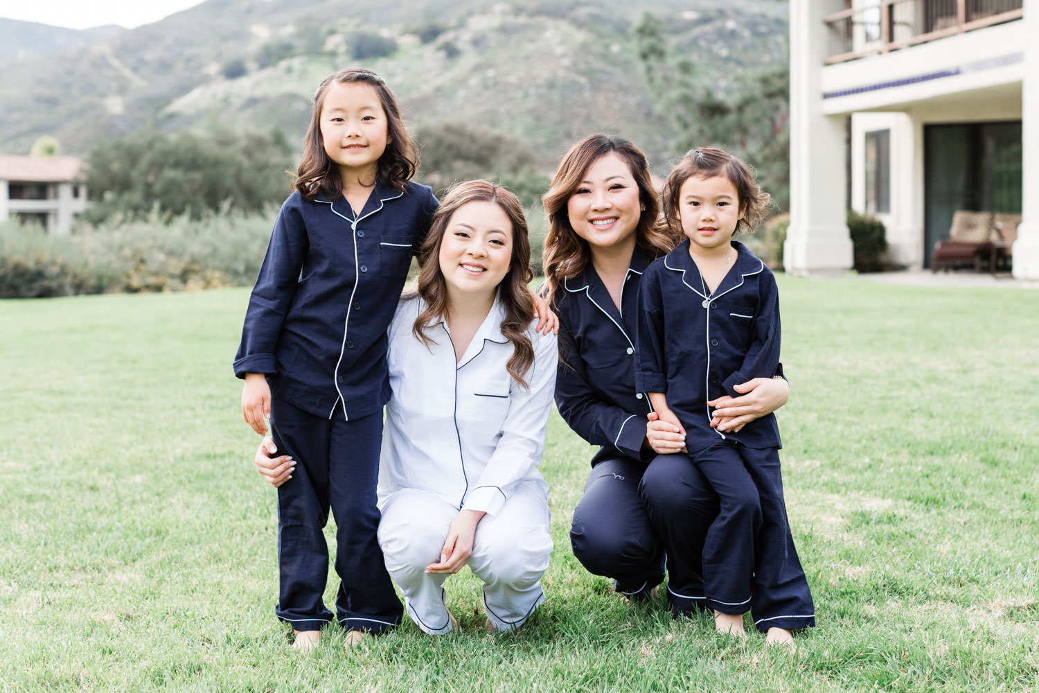 Bride with bridesmaids and flower girls in matching pajamas, Cavin Elizabeth Photography