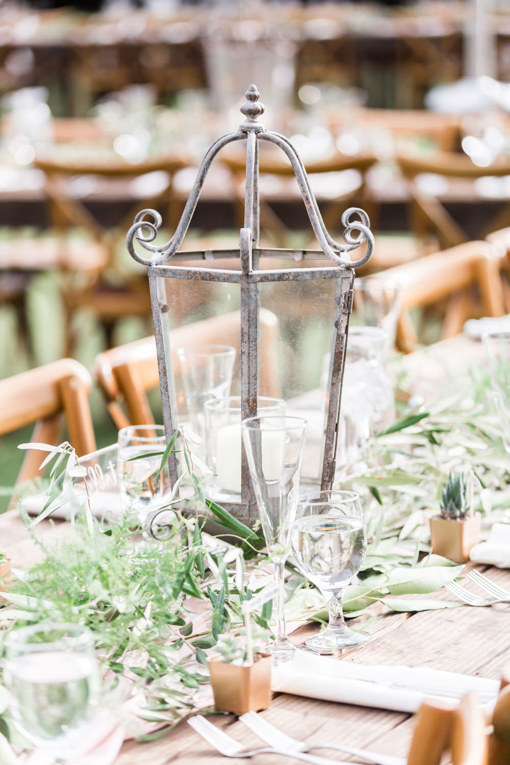Lantern centerpiece for Ethereal Open Air Resort Wedding Reception outdoors with market lights, Cavin Elizabeth Photography