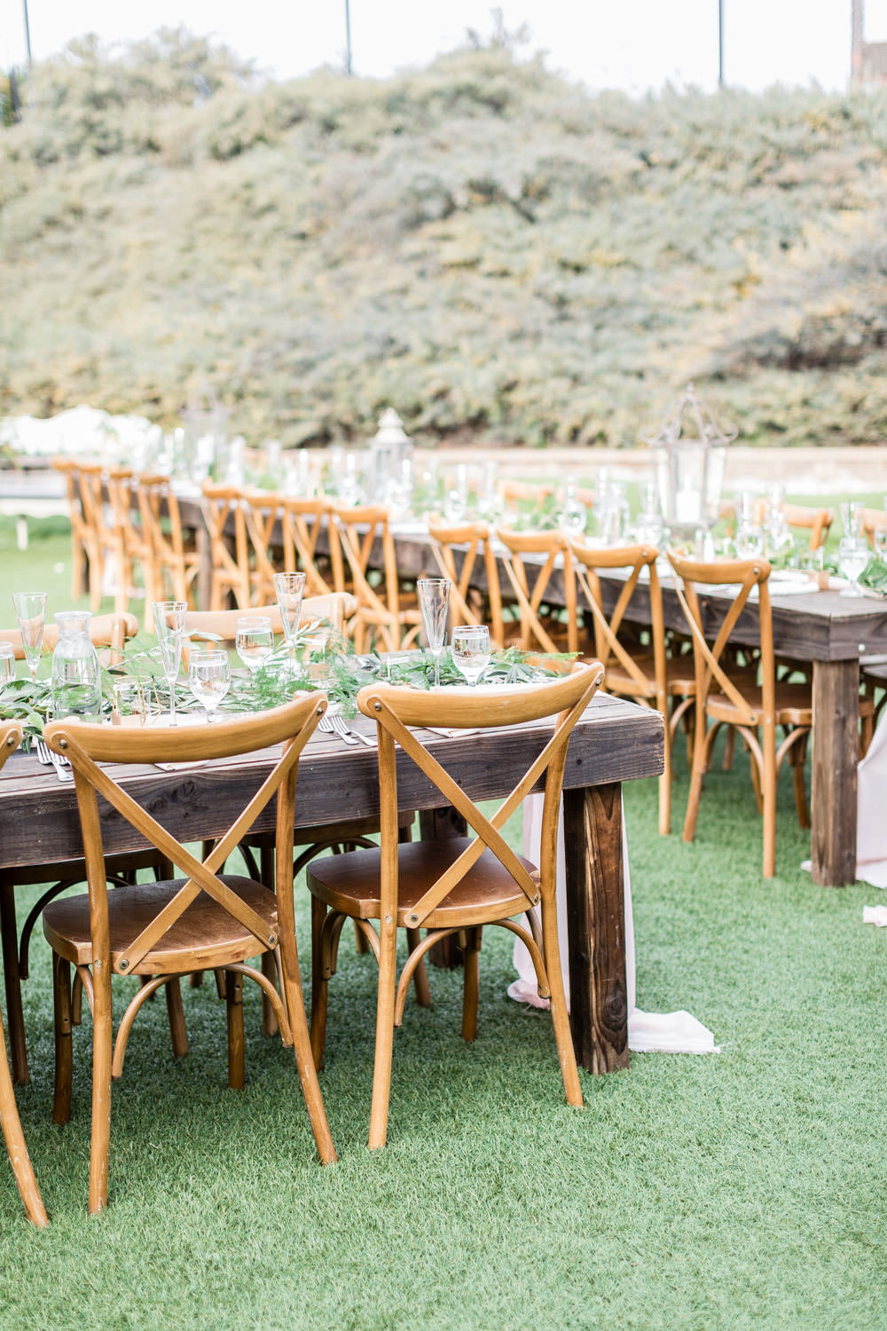 Crossback chairs at Ethereal Open Air Resort Wedding Reception outdoors with market lights, Cavin Elizabeth Photography