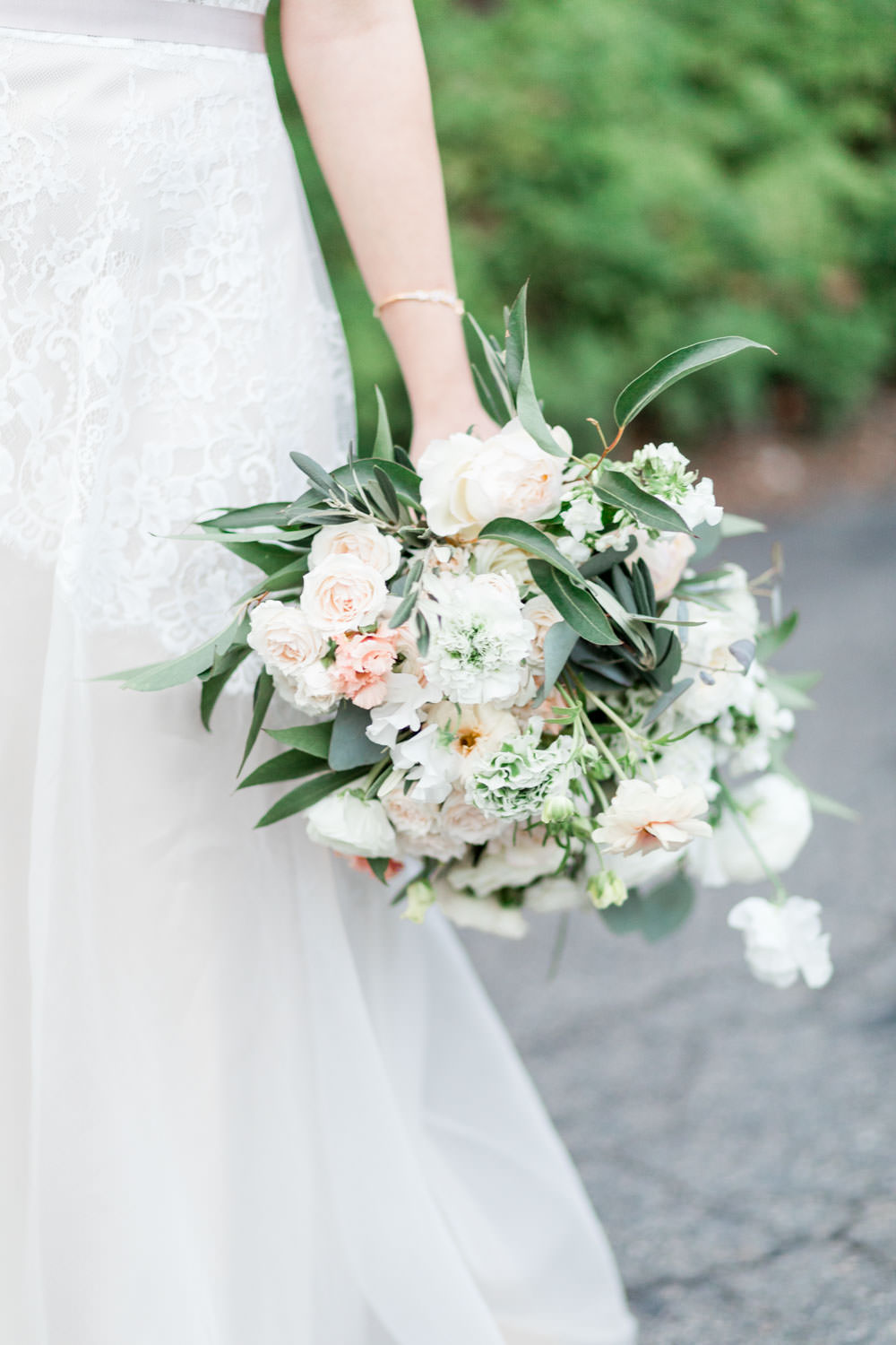 Bride and groom portrait at Ethereal Open Air Resort, Anais Anette lace sleeveless gown with white and green bouquet, Cavin Elizabeth Photography