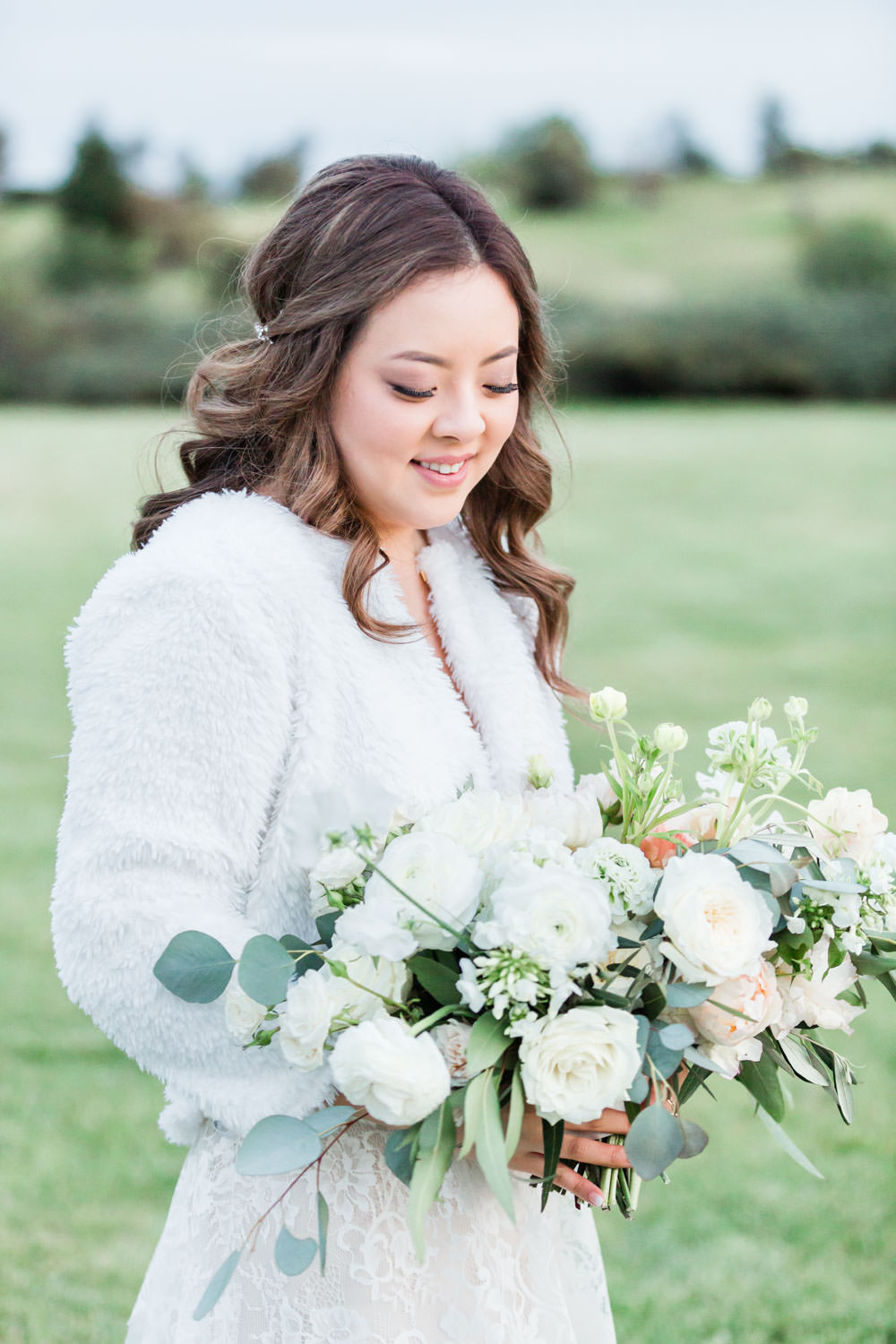 Bridal portrait with winter coat and white and green bouquet, Cavin Elizabeth Photography