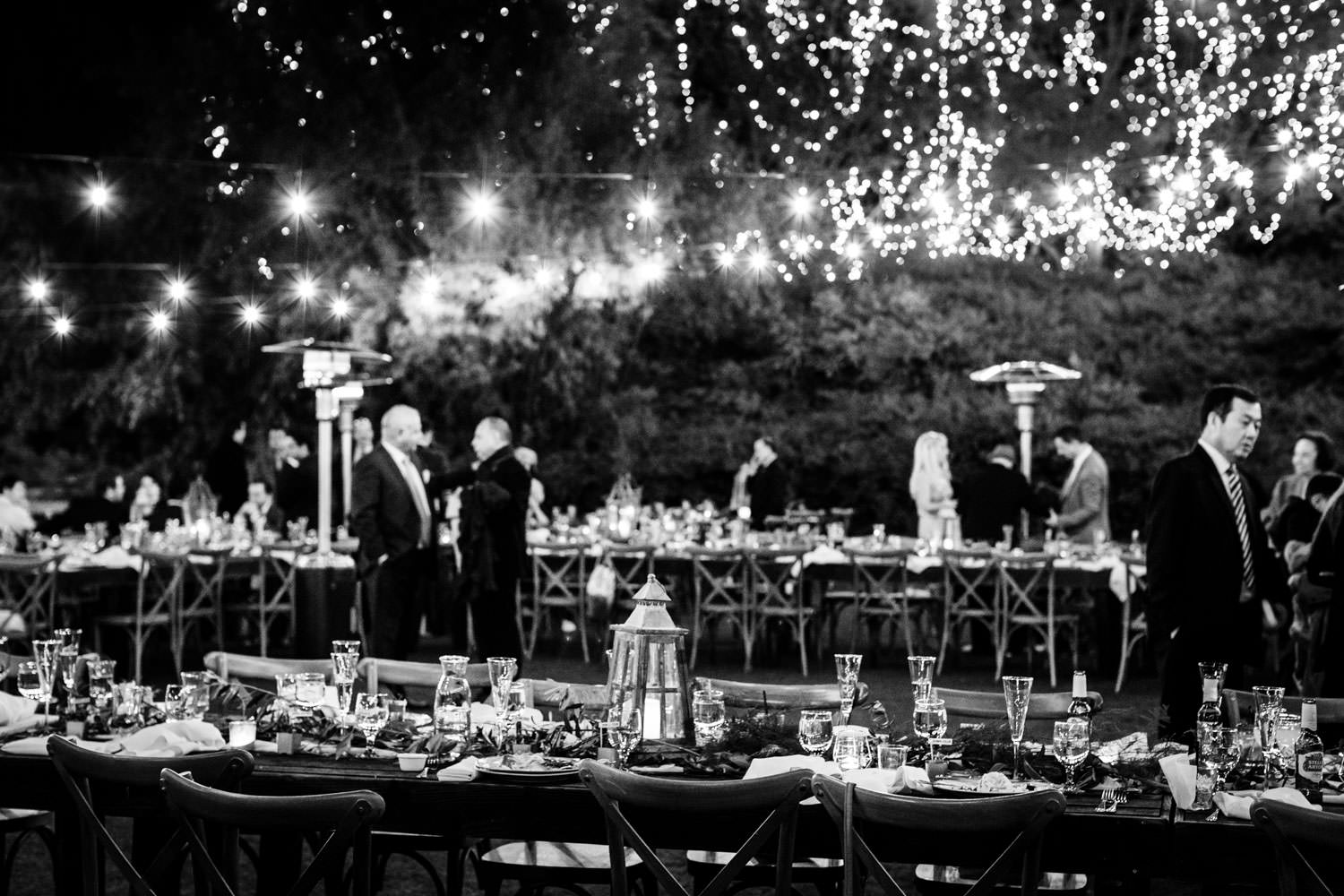 Black and white nighttime reception photo, Ethereal Open Air Resort Wedding with market lights and twinkle lights in the trees, Cavin Elizabeth Photography
