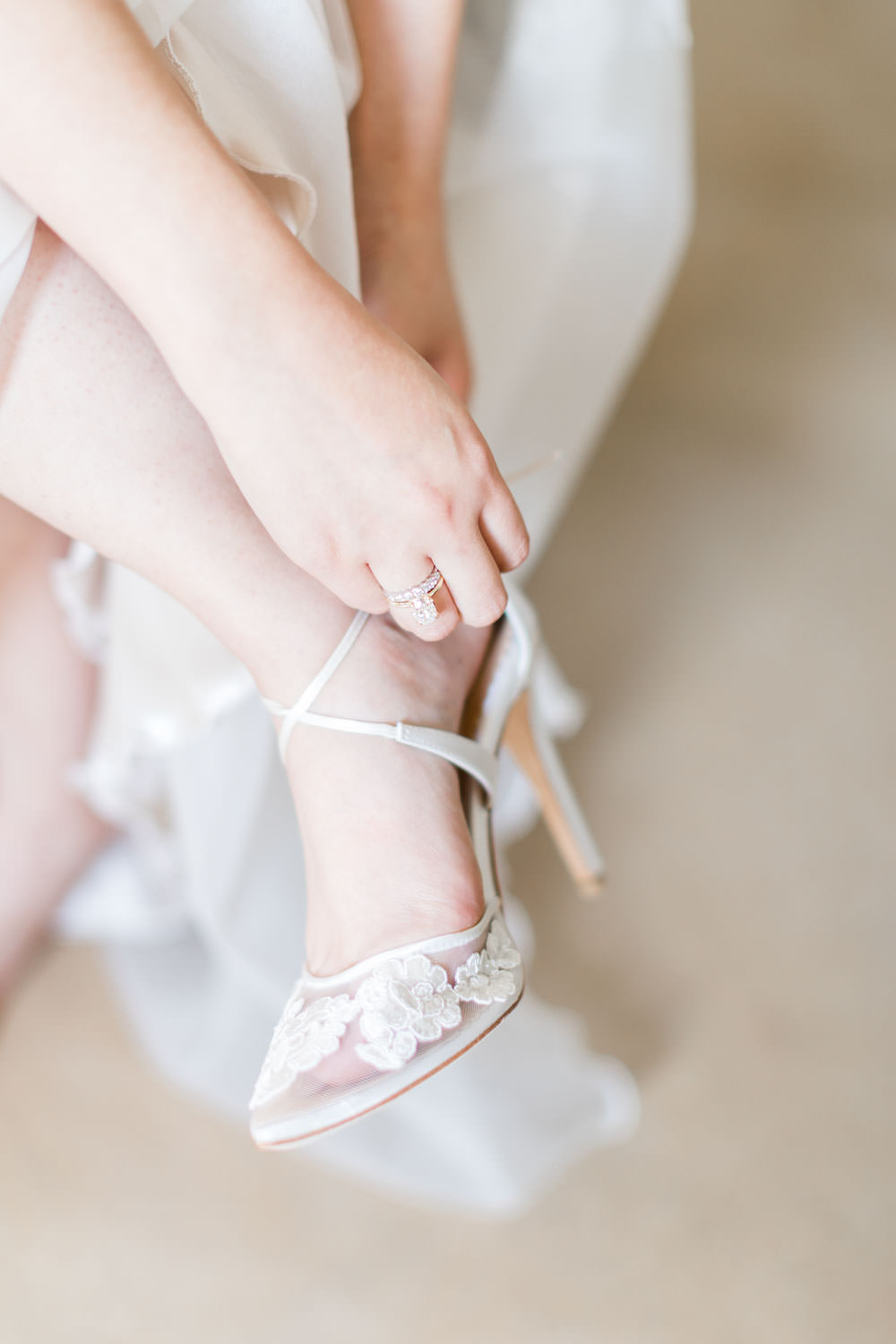 Bride putting on Bella Belle shoes at Ethereal Open Air Resort, Cavin Elizabeth Photography