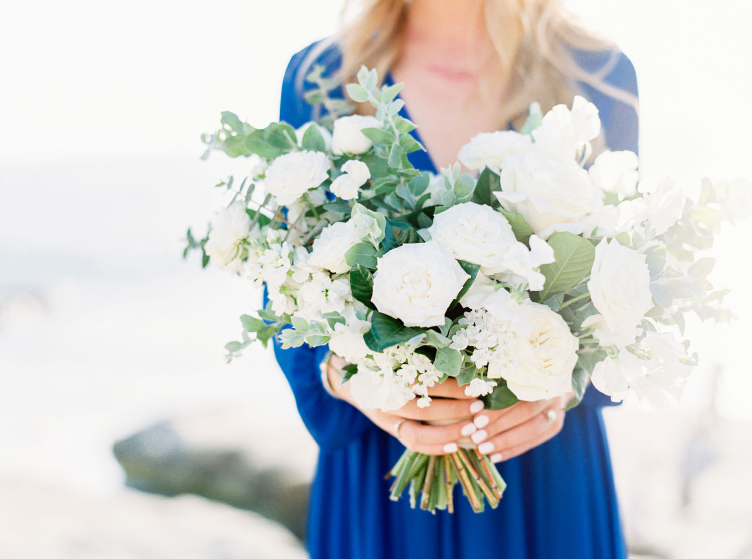 Green and white engagement bouquet, Contax 645 Fuji 400h San Diego wedding film photographer, La Jolla Windansea Engagement Photos with bride in a blue long sleeved flowy dress, Cavin Elizabeth Photography