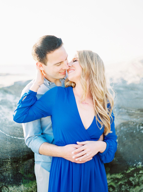 Rocky shores of La Jolla beach, Contax 645 Fuji 400h San Diego wedding film photographer, La Jolla Windansea Engagement Photos with bride in a blue long sleeved flowy dress, Cavin Elizabeth Photography
