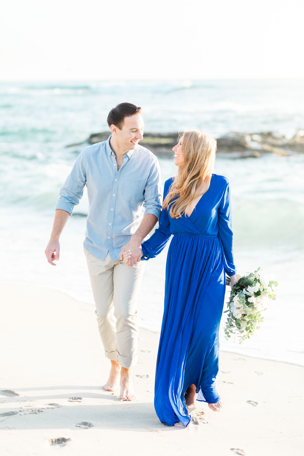 Green and white engagement bouquet, La Jolla Windansea Engagement Photos with bride in a blue long sleeved flowy dress, Cavin Elizabeth Photography