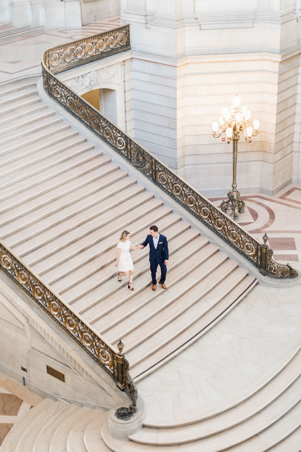Couple walking down stairs of San Francisco City Hall, Cavin Elizabeth Photography