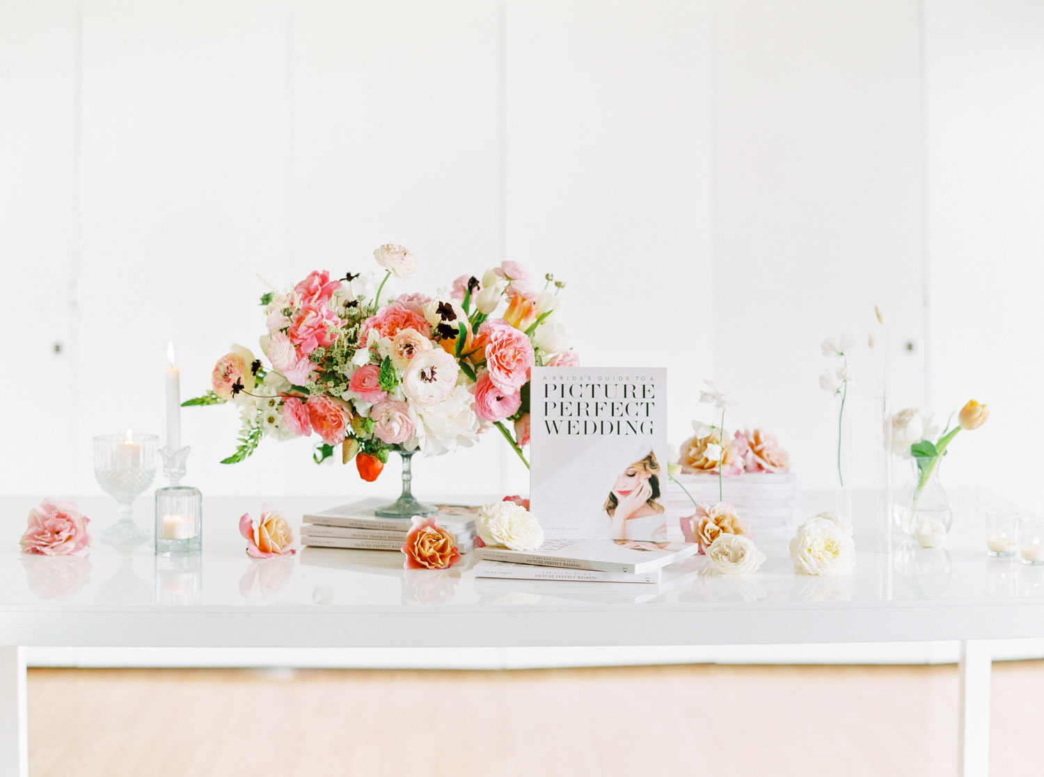 Wedding book for brides and grooms, White table with Pink green white peach centerpiece on film, Romantic Colorful Floral Arrangements by Organic Flora, Cavin Elizabeth Photography