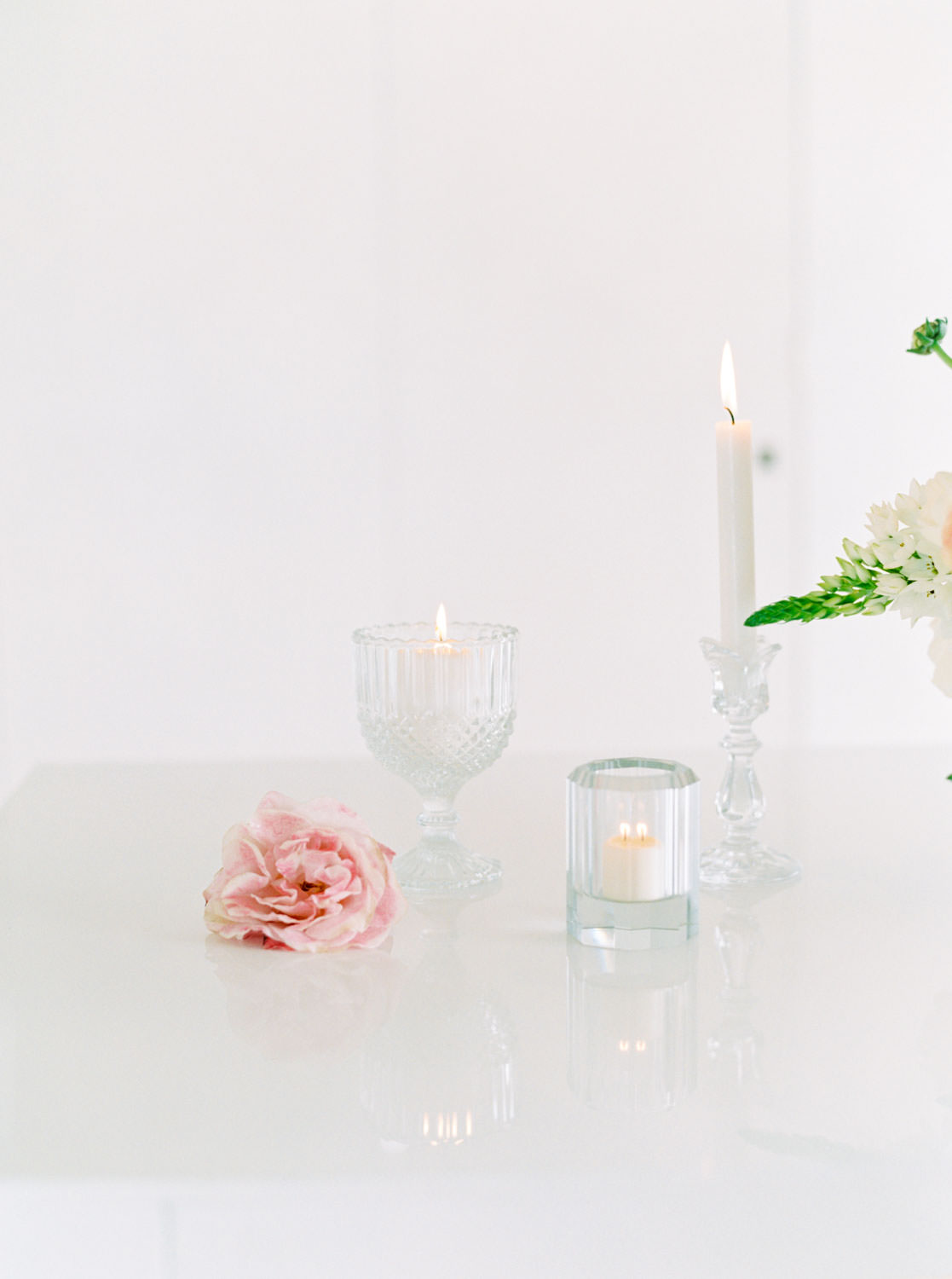 Candles in glass crystal goblets votives and taper holders, Cavin Elizabeth Photography