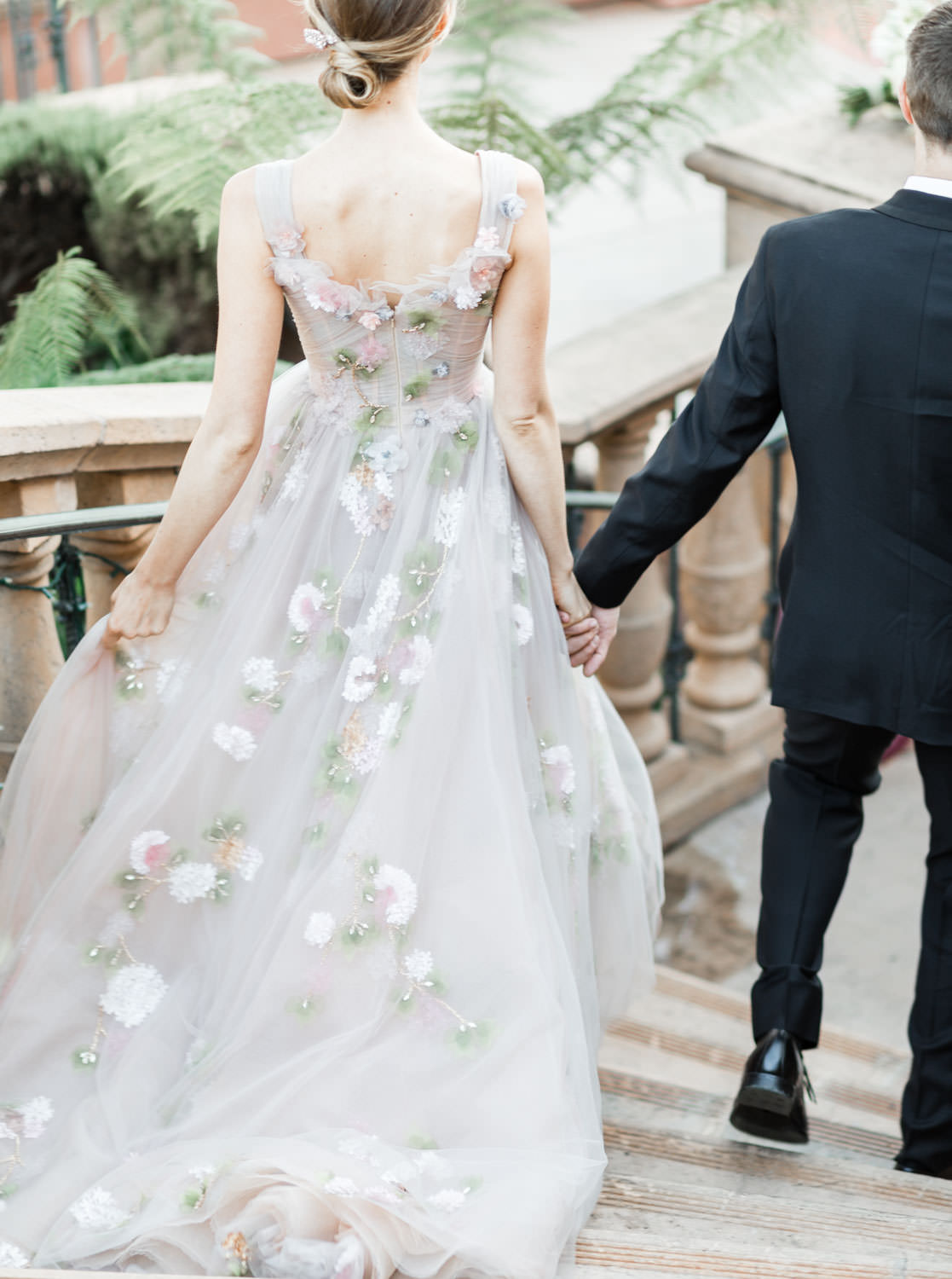 Bride on staircase in a Marchesa blush neutral floral gown, Fairmont Grand Del Mar Wedding by Cavin Elizabeth Photography