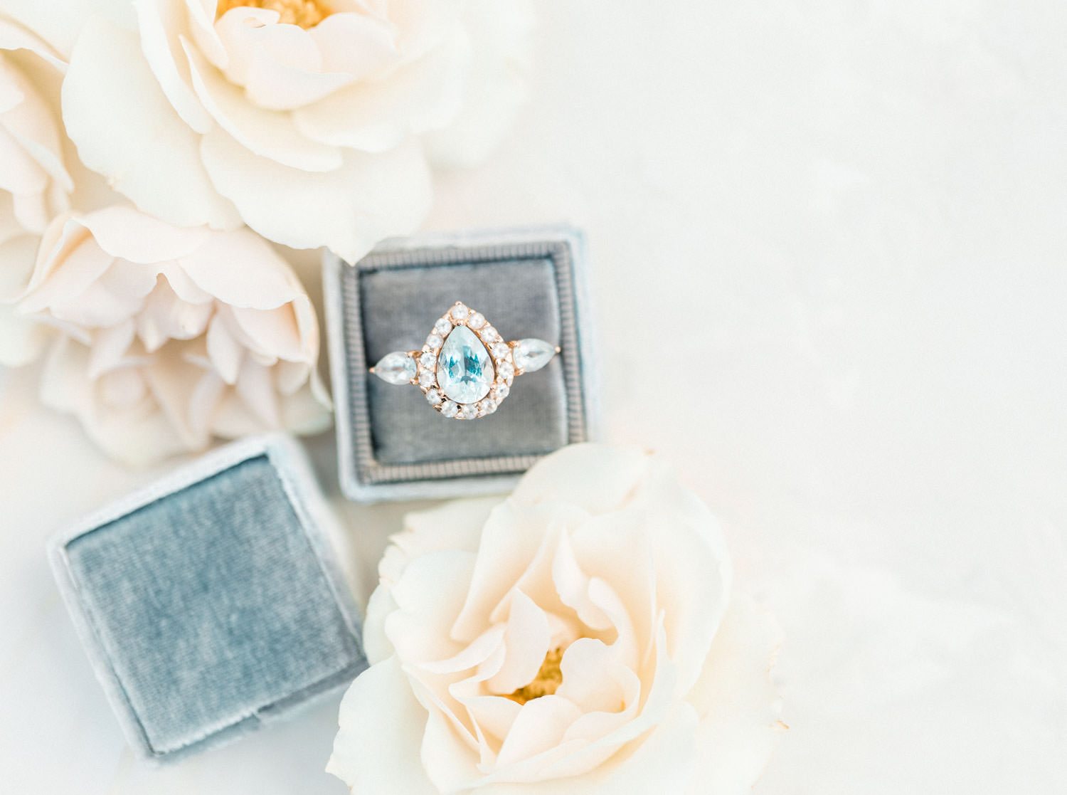 Blue diamond pear engagement ring in blue gray Mrs Box, Cavin Elizabeth Photography