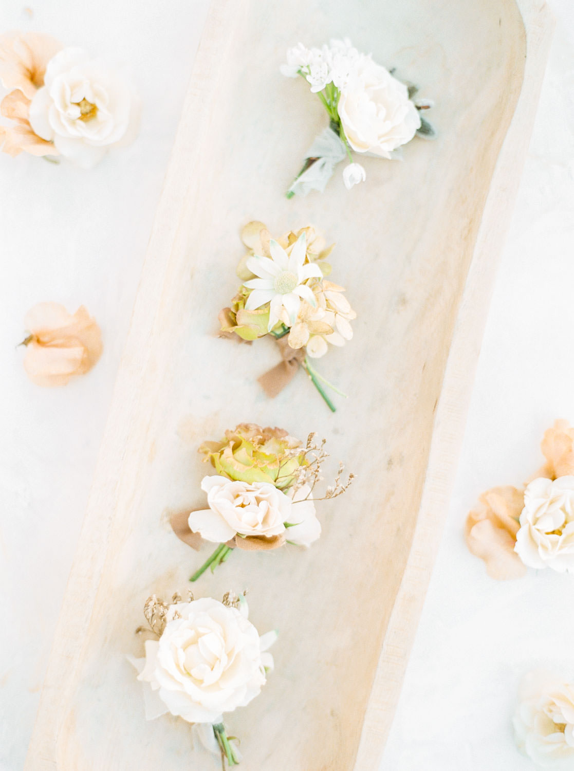 White boutonnieres in a fine art style captured on film, Cavin Elizabeth Photography